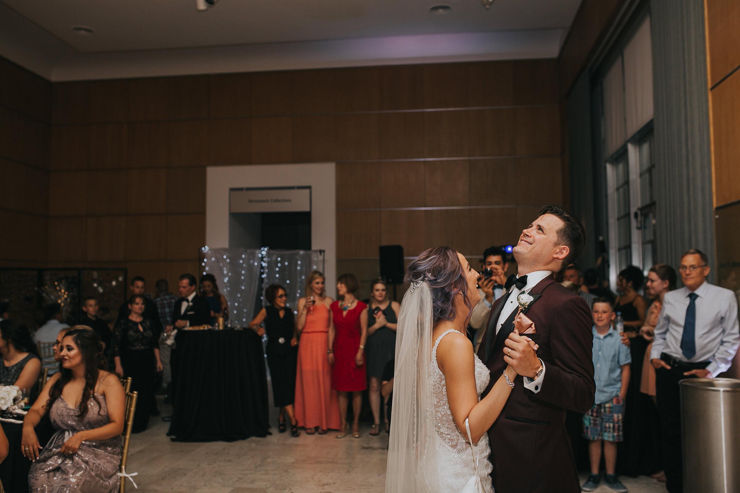 bride-groom-first-dance-laughing-desmoines-iowa-art-center-raelyn-ramey-photography.jpg