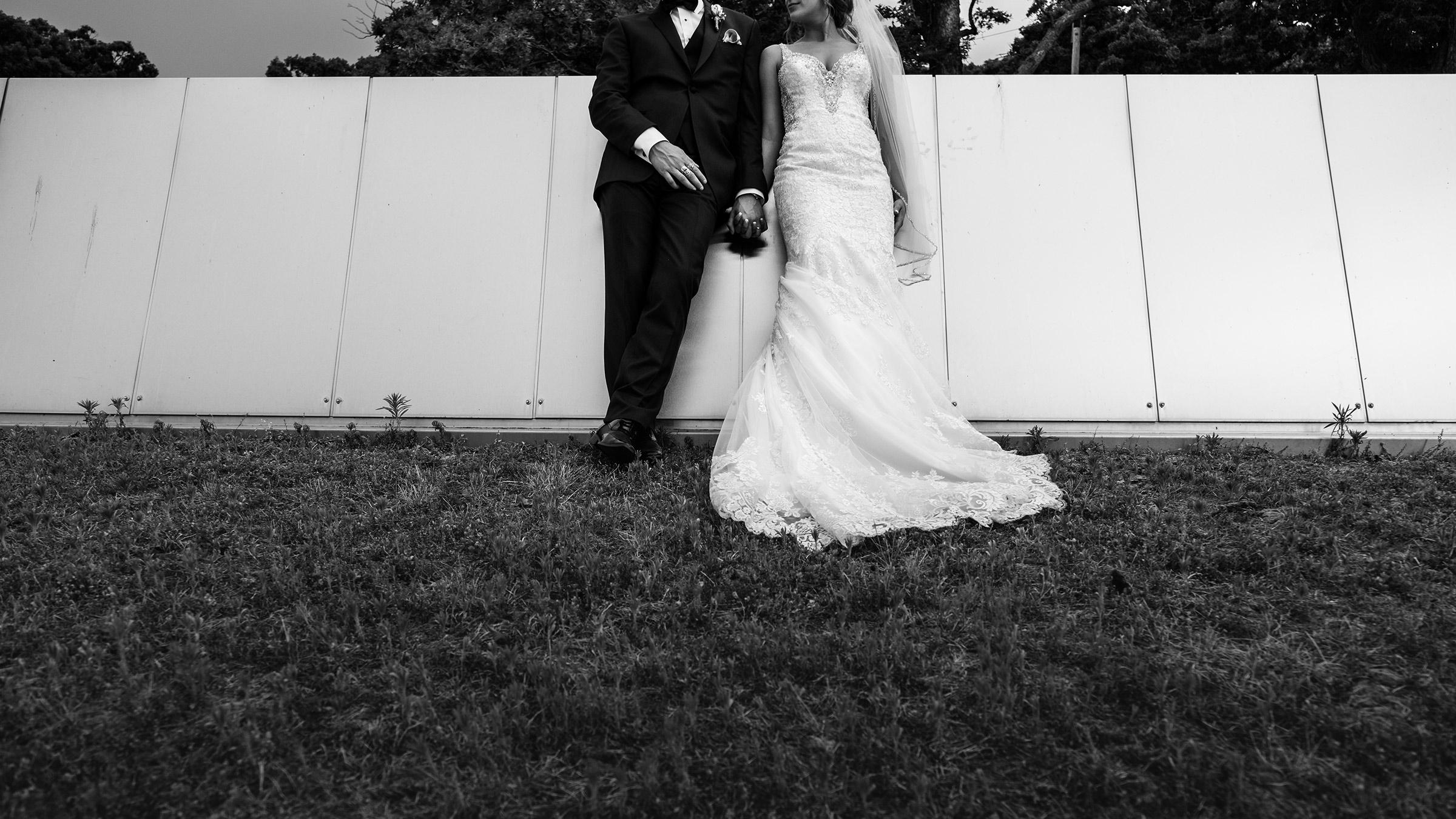 bride-groom-holding-hands-no-heads-desmoines-iowa-art-center-raelyn-ramey-photography.jpg