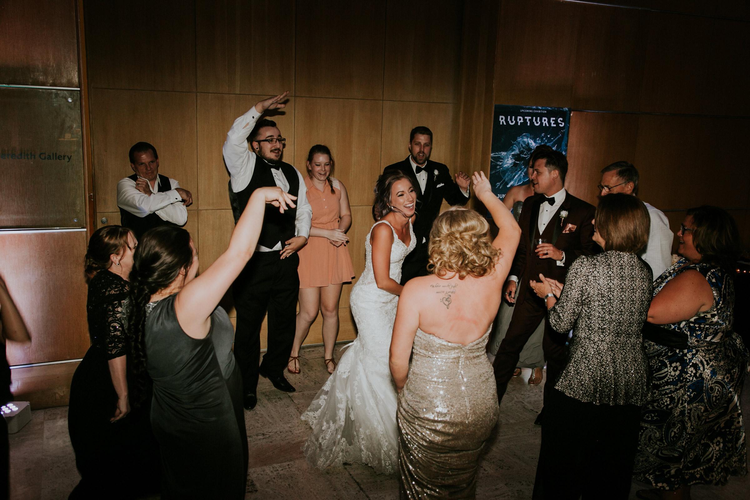 bride-in-center-of-dance-floor-desmoines-iowa-art-center-raelyn-ramey-photography.jpg