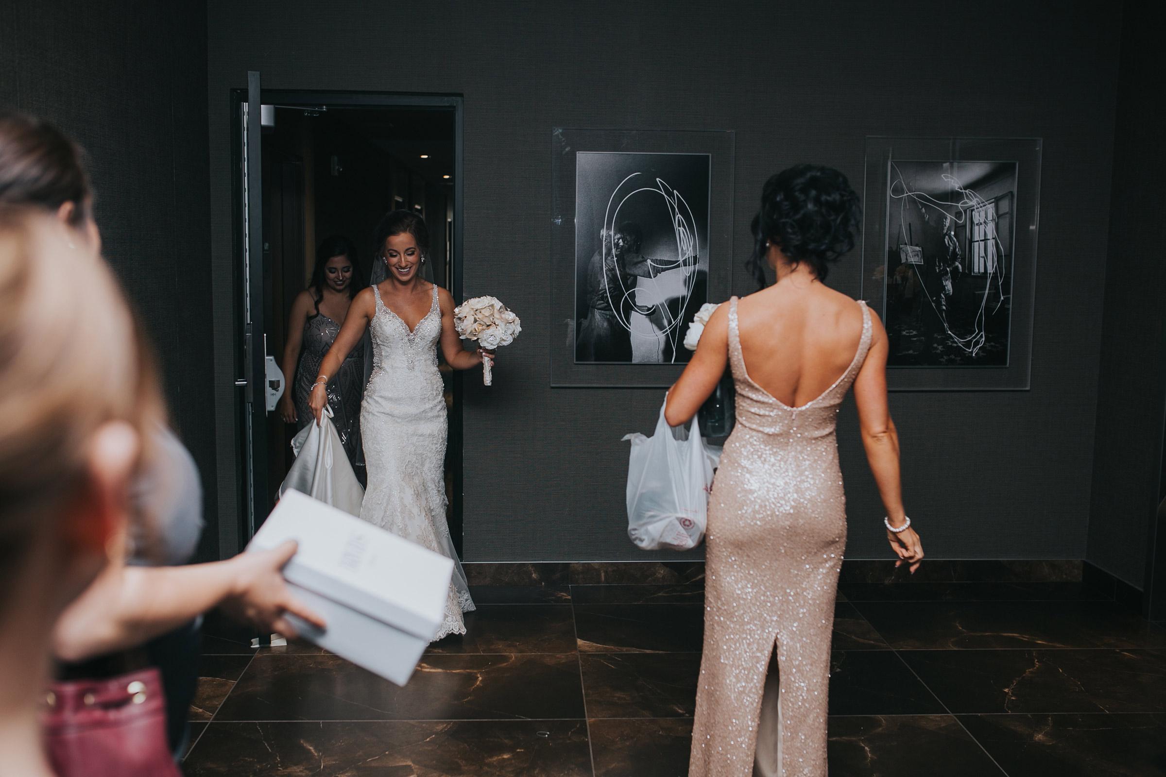 bride-leaving-hotel-room-desmoines-iowa-ac-hotel-raelyn-ramey-photography.jpg