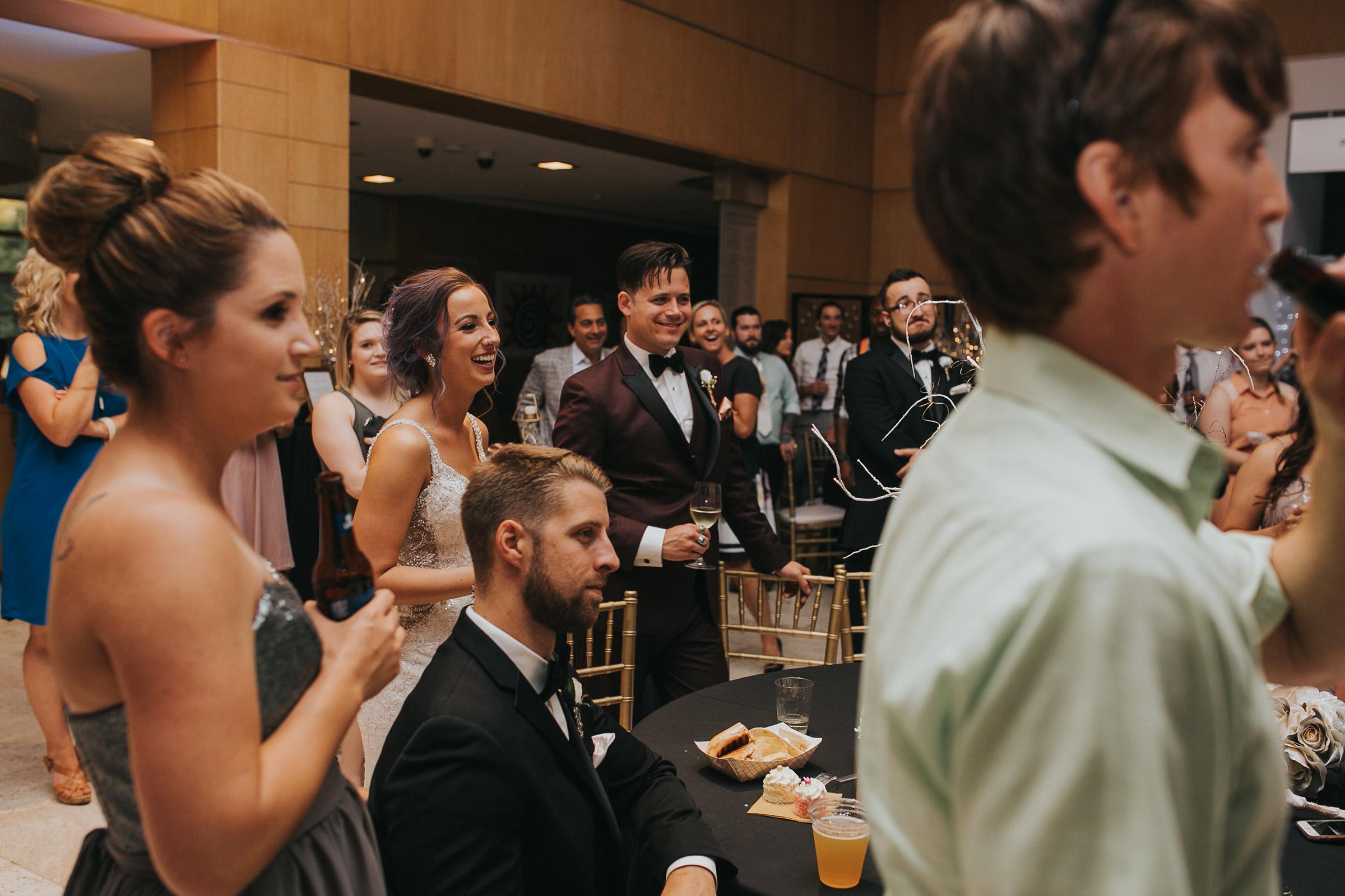 bride-laughing-at-bridesmaid-speech-desmoines-iowa-art-center-raelyn-ramey-photography.jpg