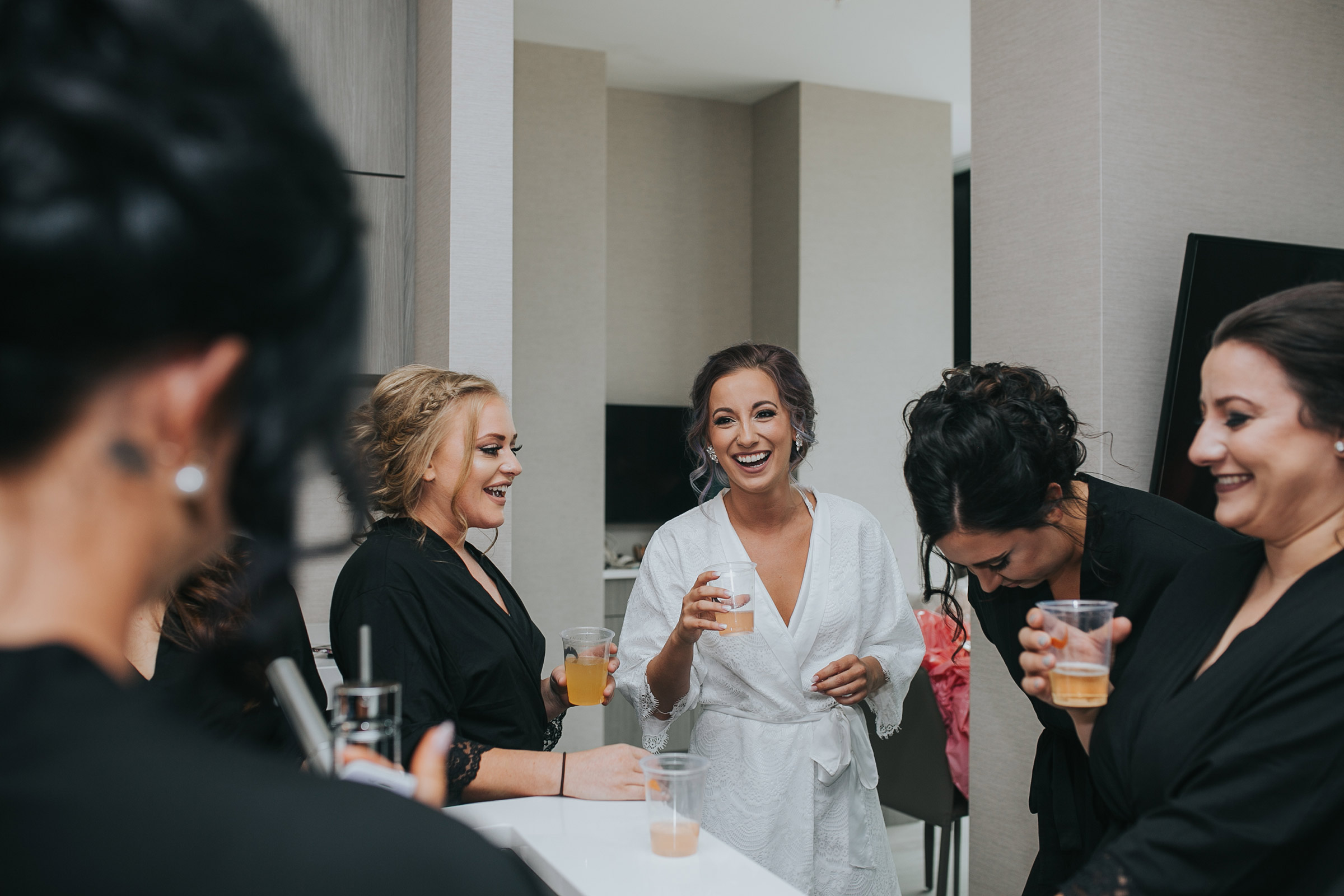 bridesmaids-laughing-with-bride-desmoines-iowa-ac-hotel-raelyn-ramey-photography.jpg