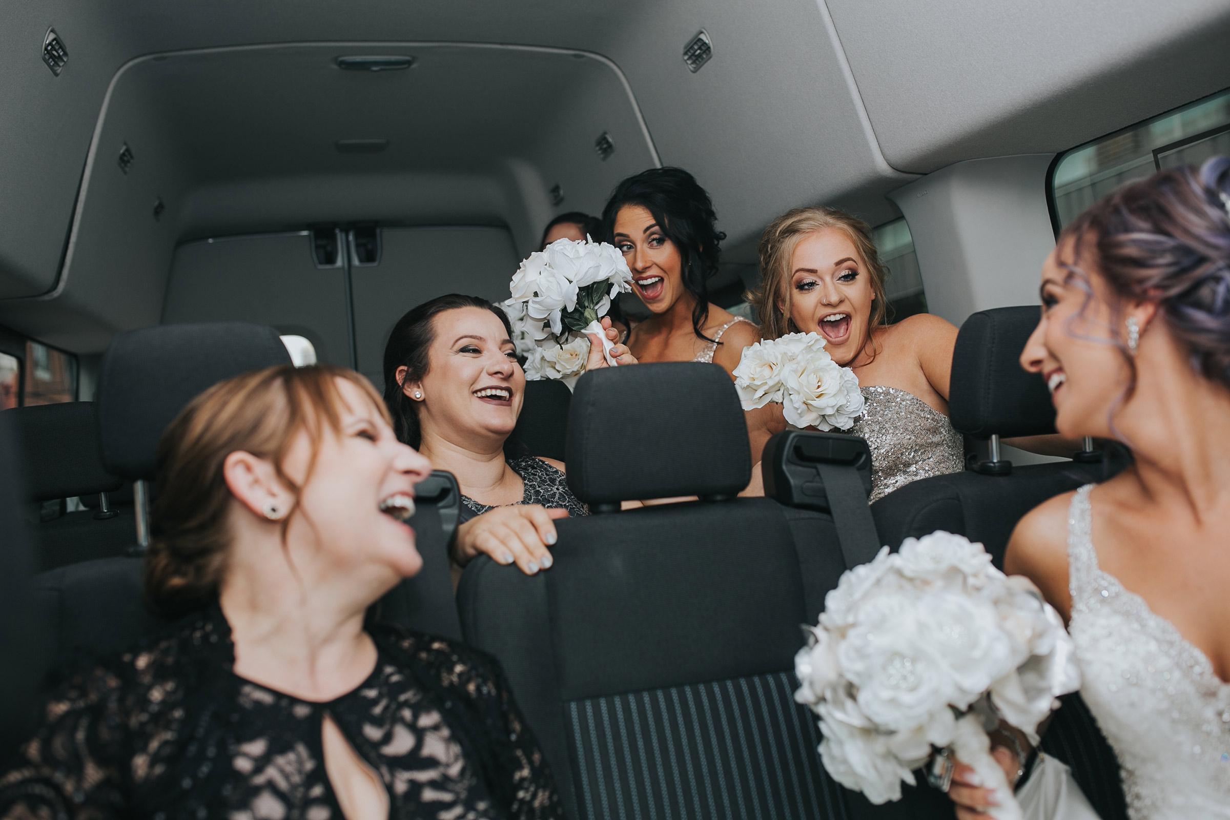 bridesmaids-on-their-way-to-ceremony-desmoines-iowa-rose-garden-raelyn-ramey-photography.jpg