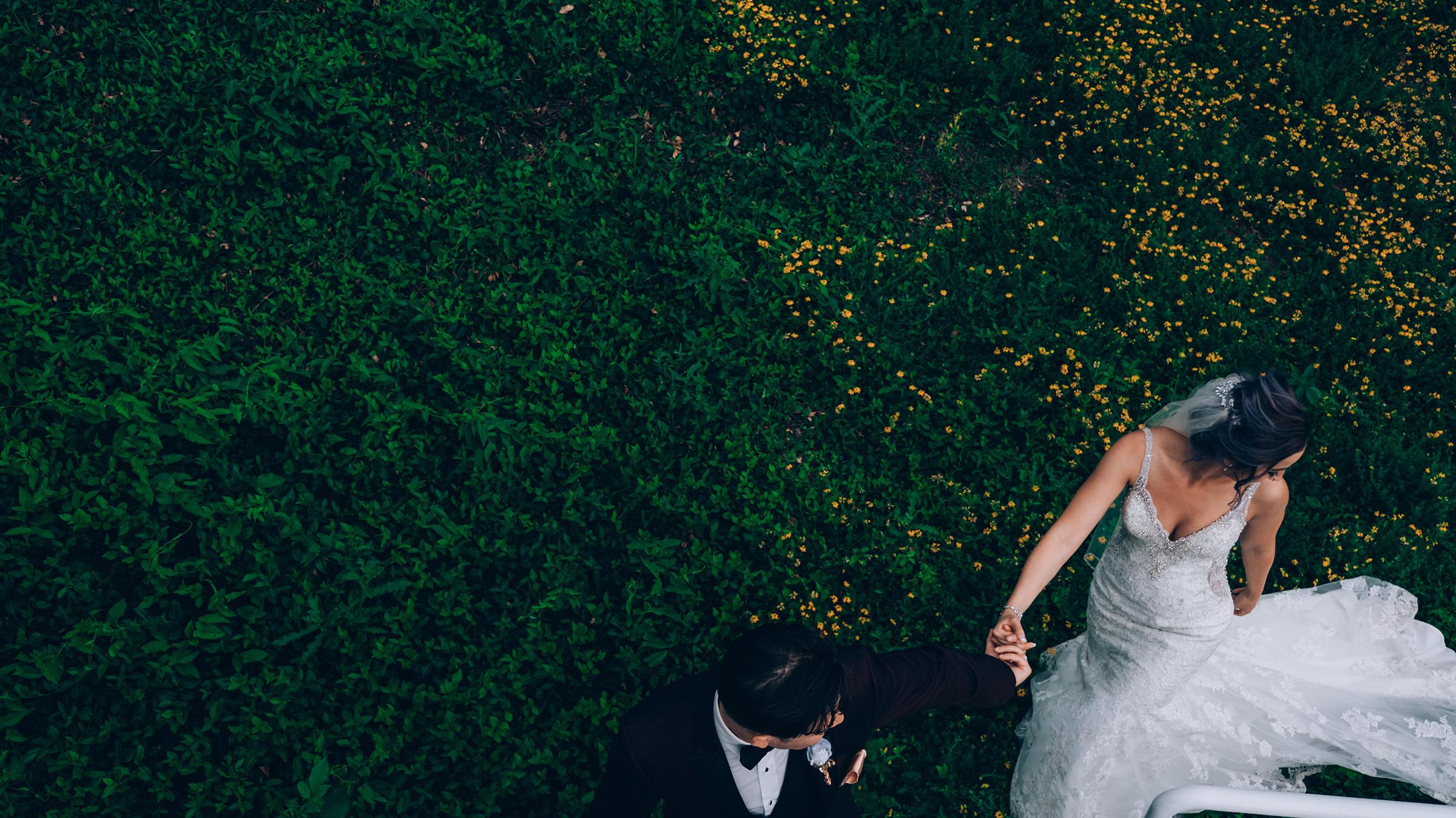 couple-walking-holding-hands-wedding-art-center-raelyn-ramey-photography.jpg