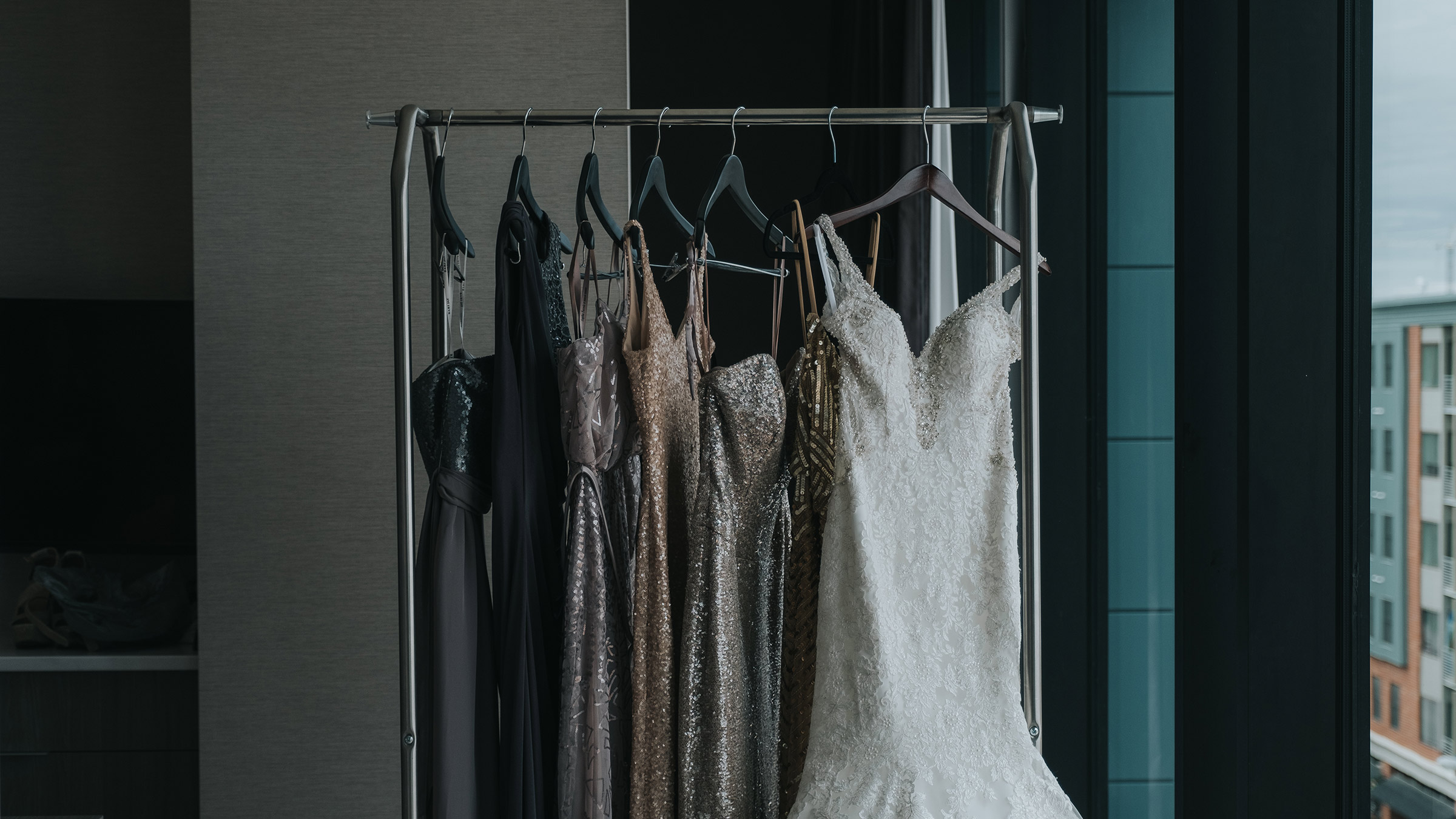 detail-shot-od-wedding-dress-and-bridesmaids-dresses-desmoines-iowa-ac-hotel-raelyn-ramey-photography.jpg