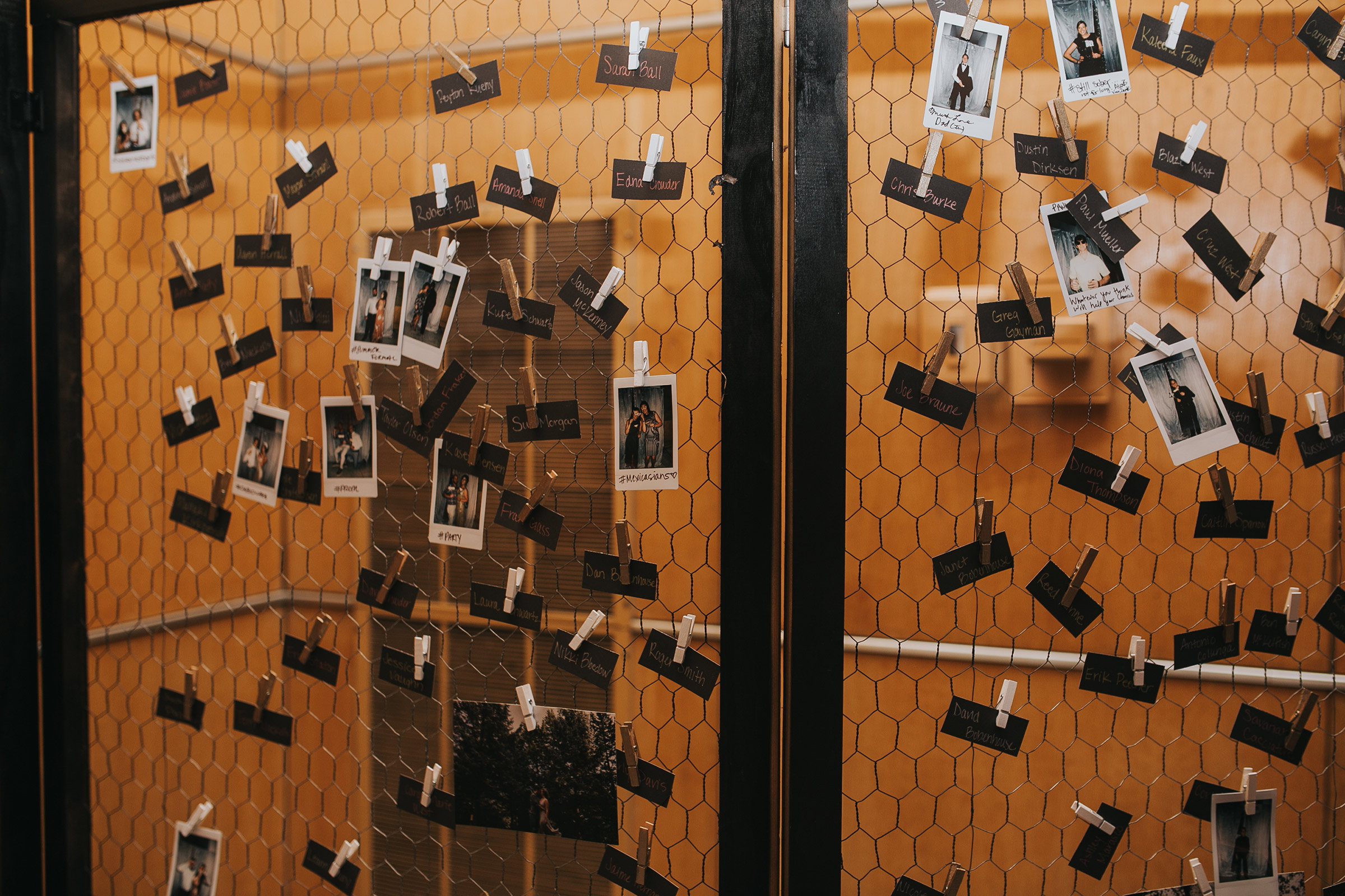 display-of-guests-polaroids-for-wedding-gift-desmoines-iowa-art-center-raelyn-ramey-photography.jpg