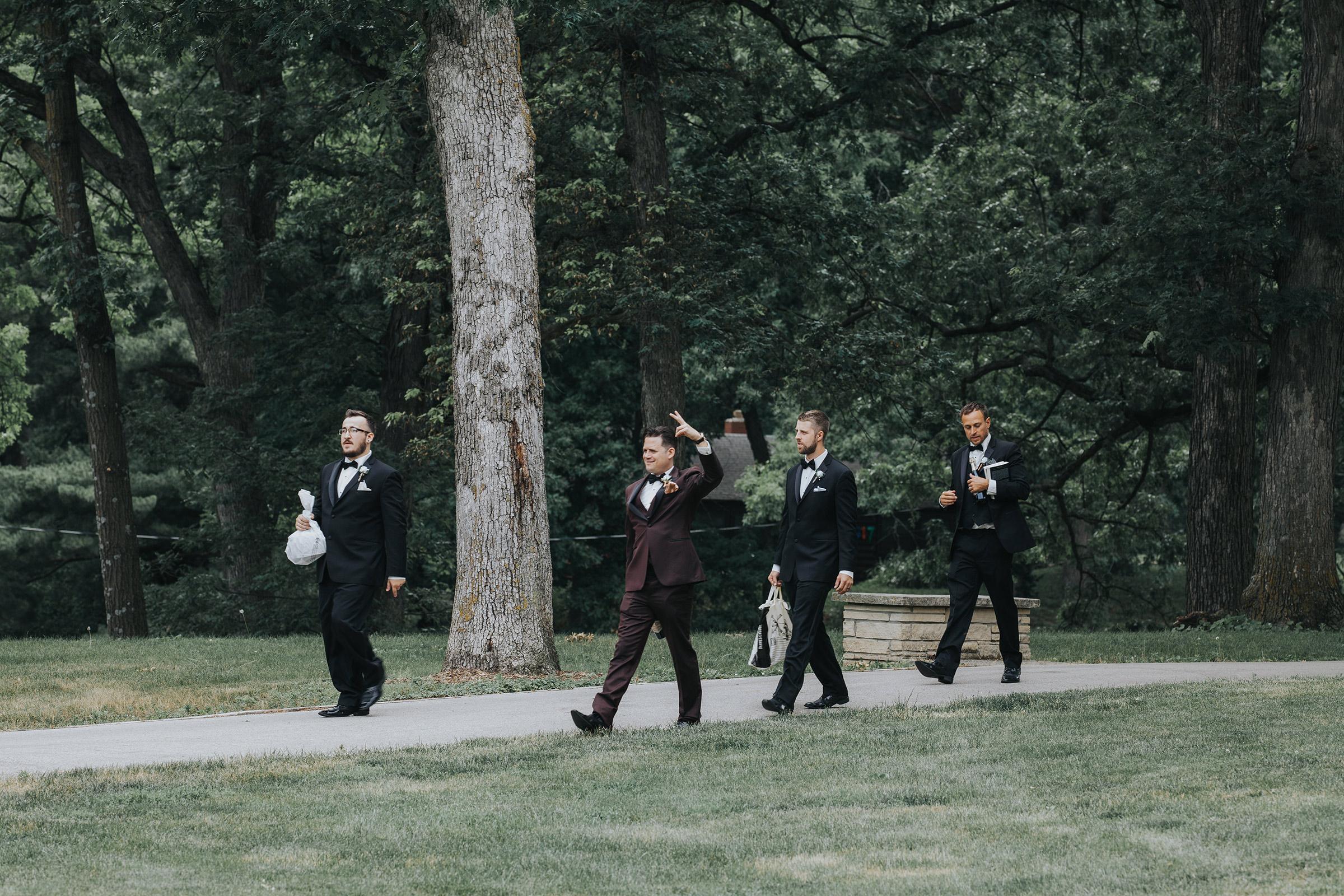 groom-arriving-to-ceremony-desmoines-iowa-rose-garden-raelyn-ramey-photography.jpg