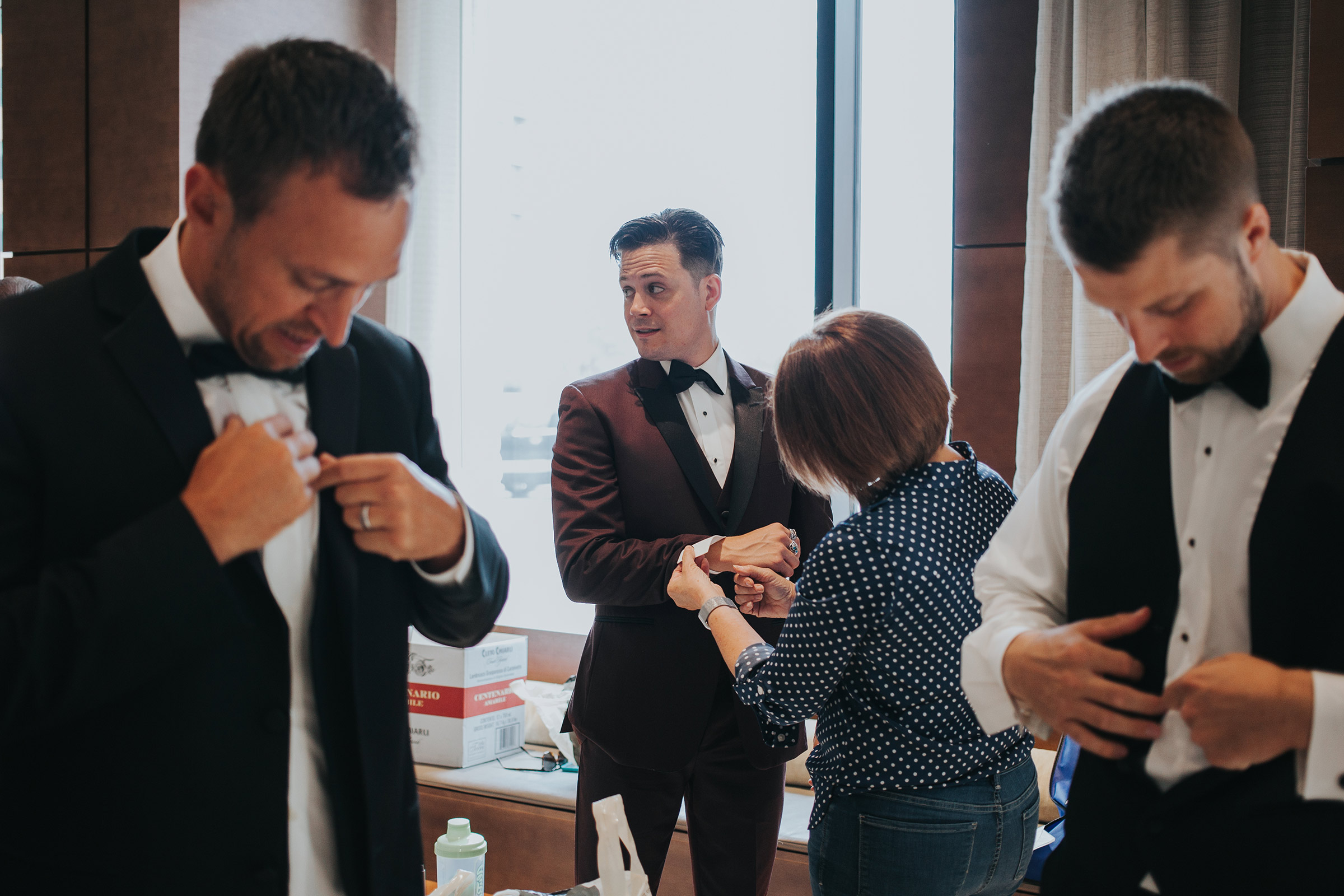 groom-getting-ready-in-lobby-desmoines-iowa-ac-hotel-raelyn-ramey-photography.jpg