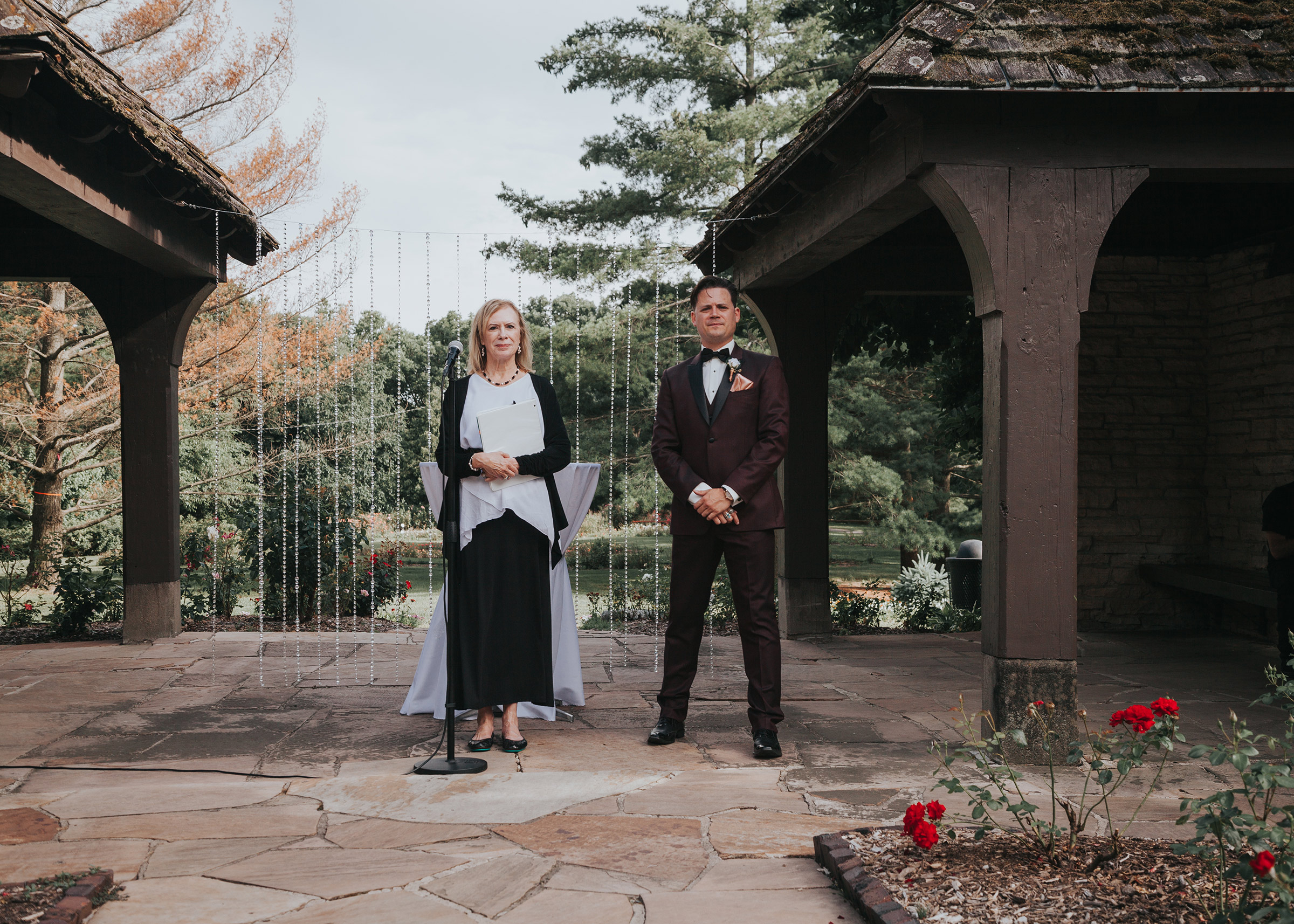 groom-waiting-for-bride-to-walk-down-aisle-desmoines-iowa-rose-garden-raelyn-ramey-photography.jpg