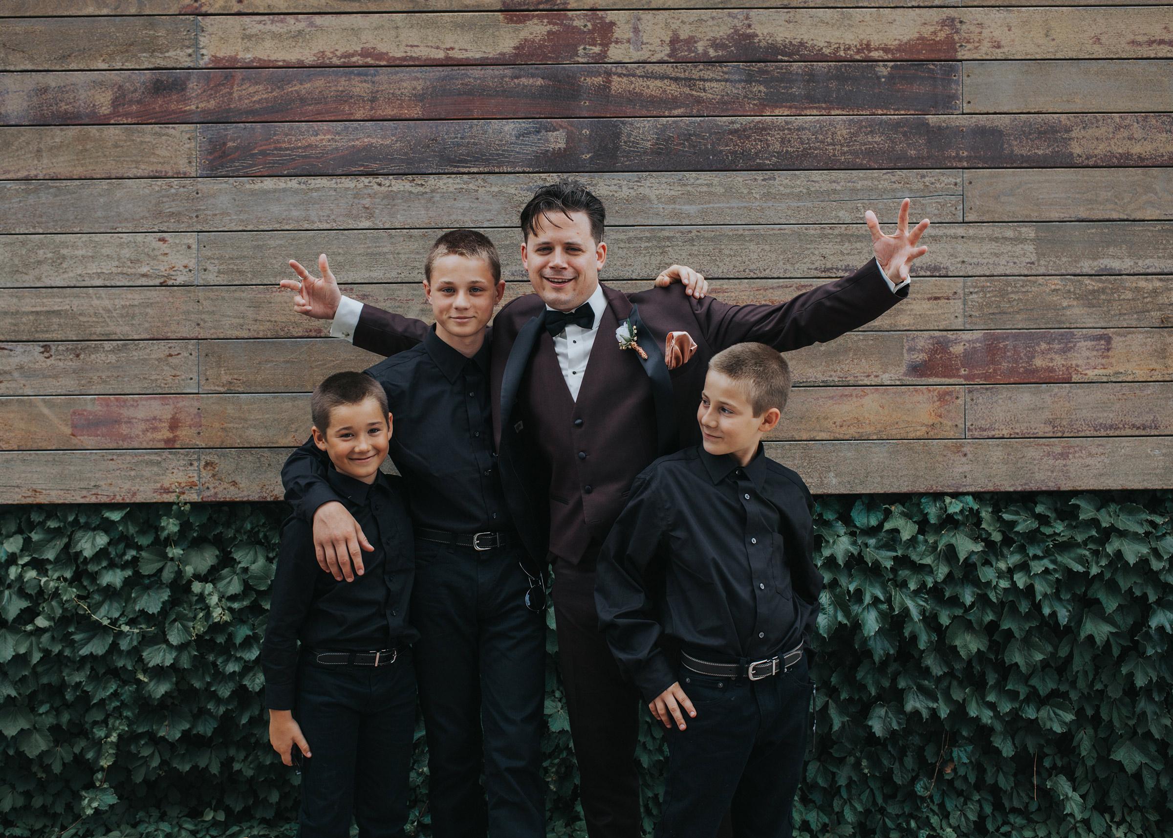 groom-with-kids-desmoines-iowa-ac-hotel-raelyn-ramey-photography.jpg