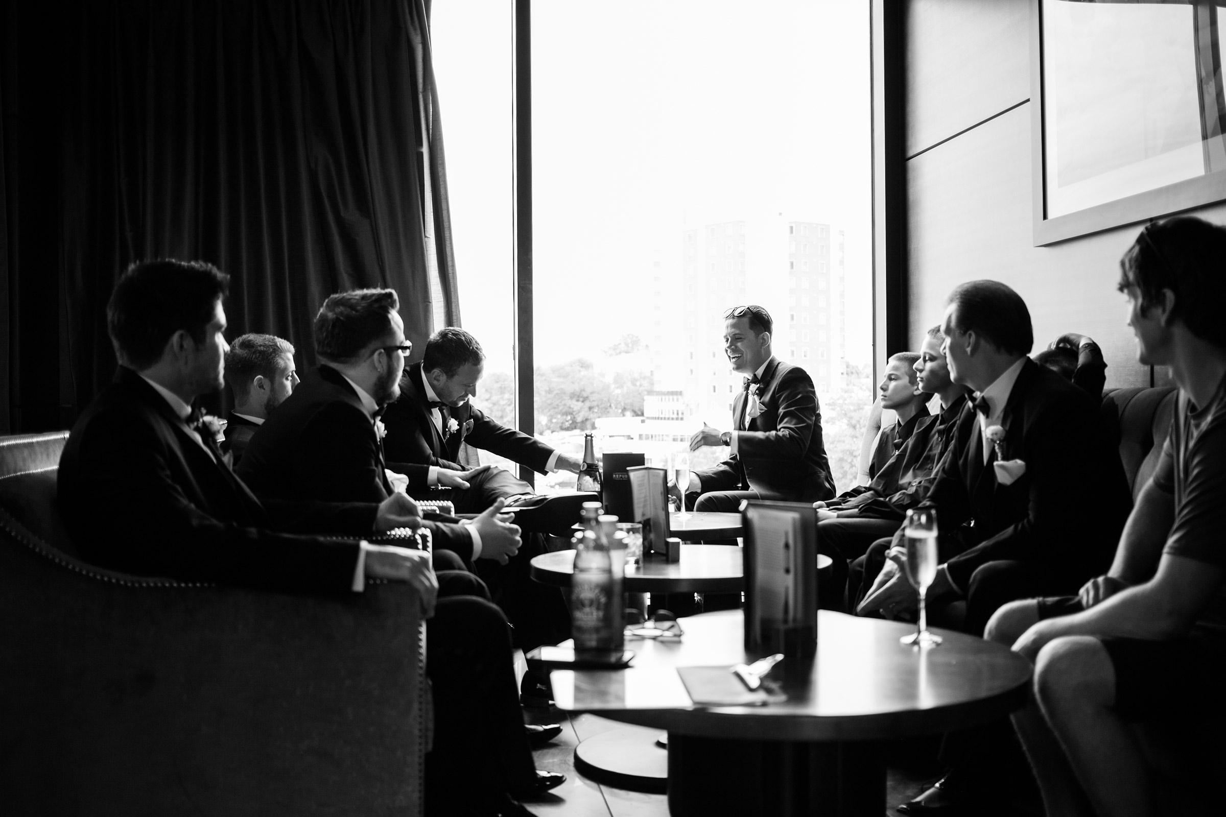 groomsmen-laughing-at-republic-on-grand-desmoines-iowa-ac-hotel-raelyn-ramey-photography.jpg