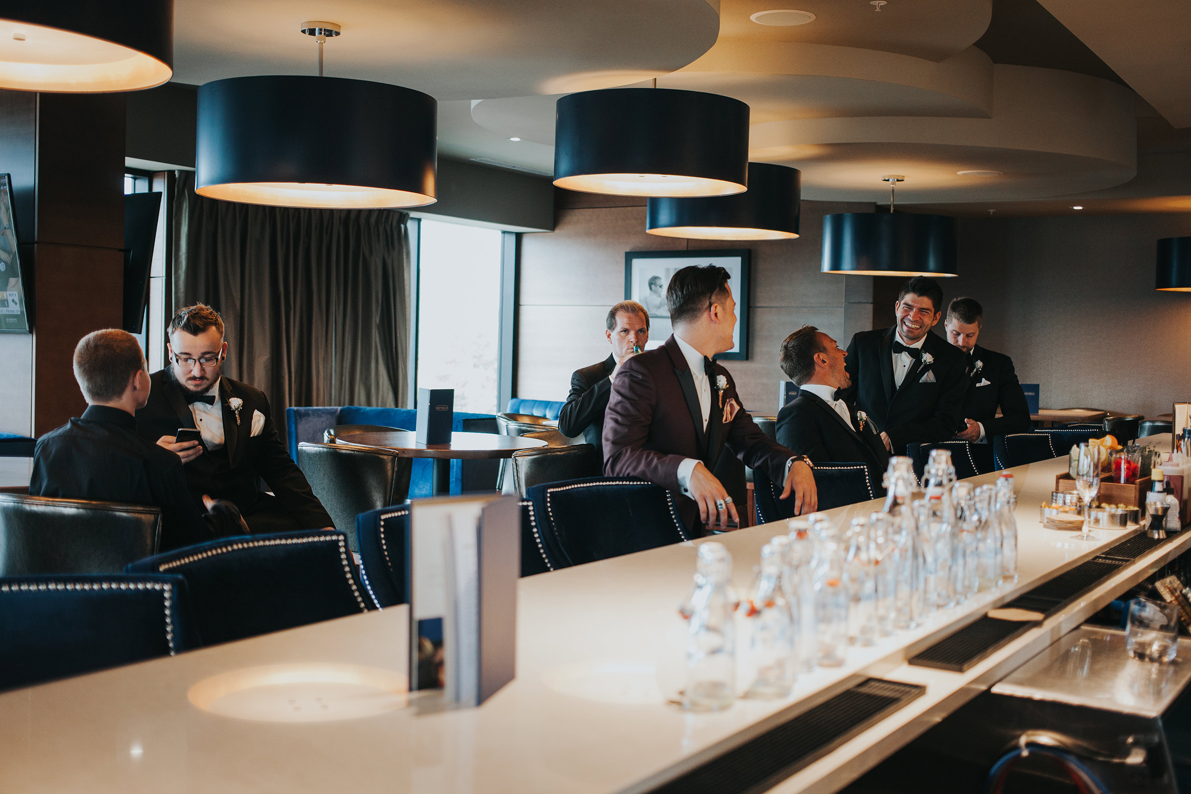groomsmen-ordering-drinks-republic-on-grand-desmoines-iowa-ac-hotel-raelyn-ramey-photography.jpg