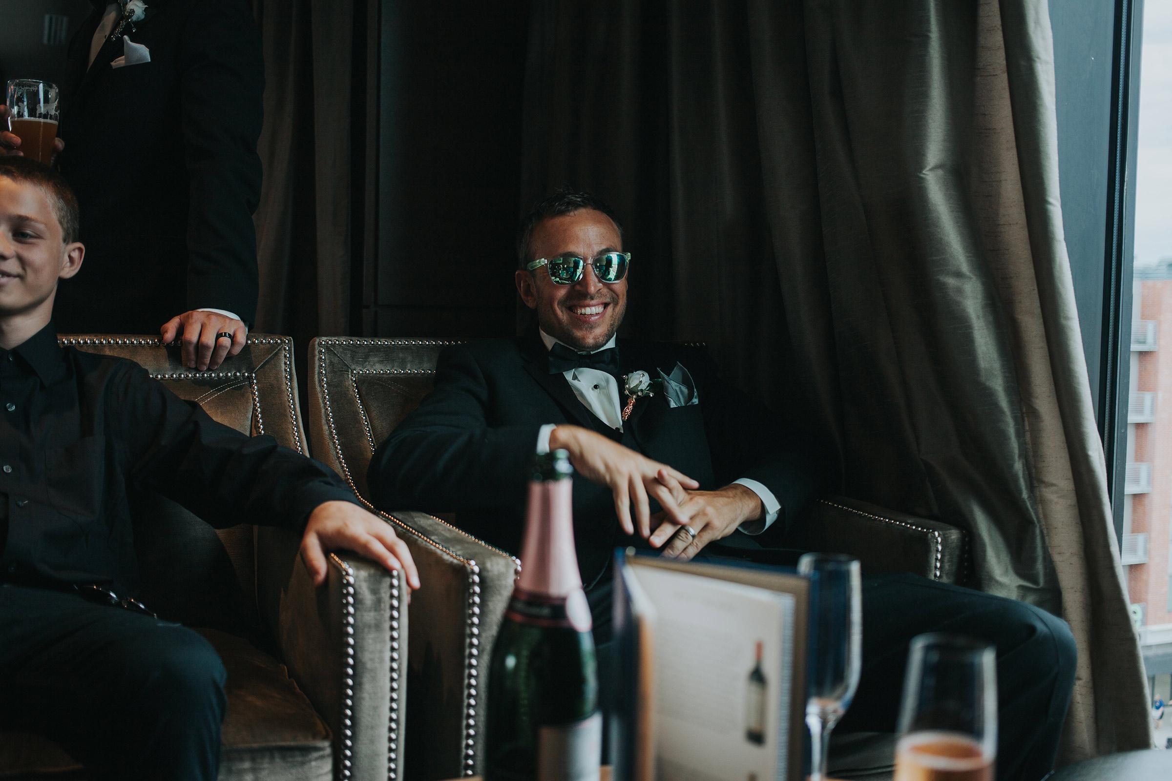 groomsmen-wearing-sunglasses-at-republic-on-grand-desmoines-iowa-ac-hotel-raelyn-ramey-photography.jpg