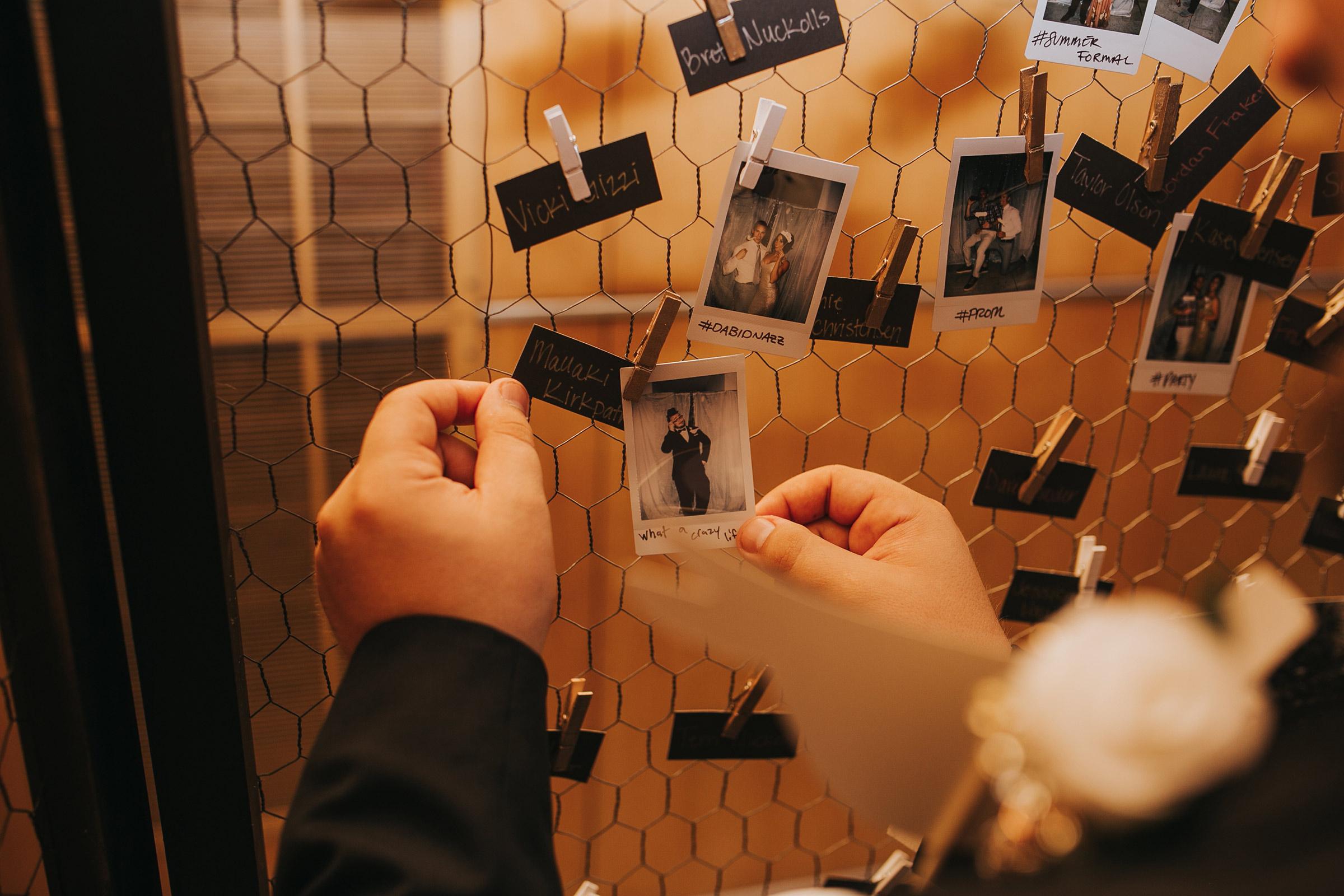 guest-hanging-polaroid-film-on-display-desmoines-iowa-art-center-raelyn-ramey-photography.jpg