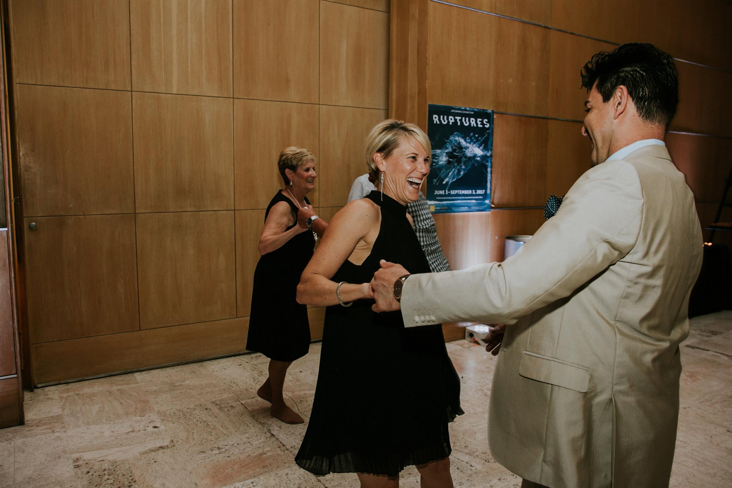 guest-laughing-dancing-on-floor-having-fun-desmoines-iowa-art-center-raelyn-ramey-photography.jpg