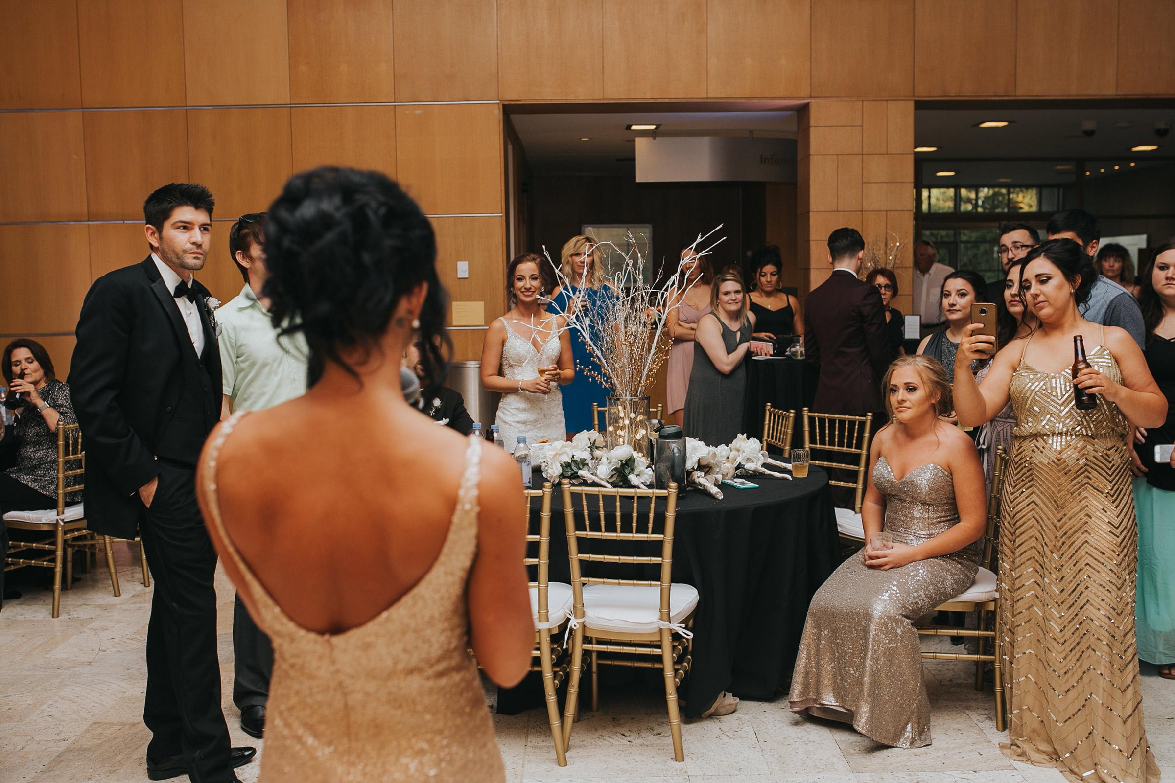guest-watching-bridesmaid-make-speech-desmoines-iowa-art-center-raelyn-ramey-photography.jpg