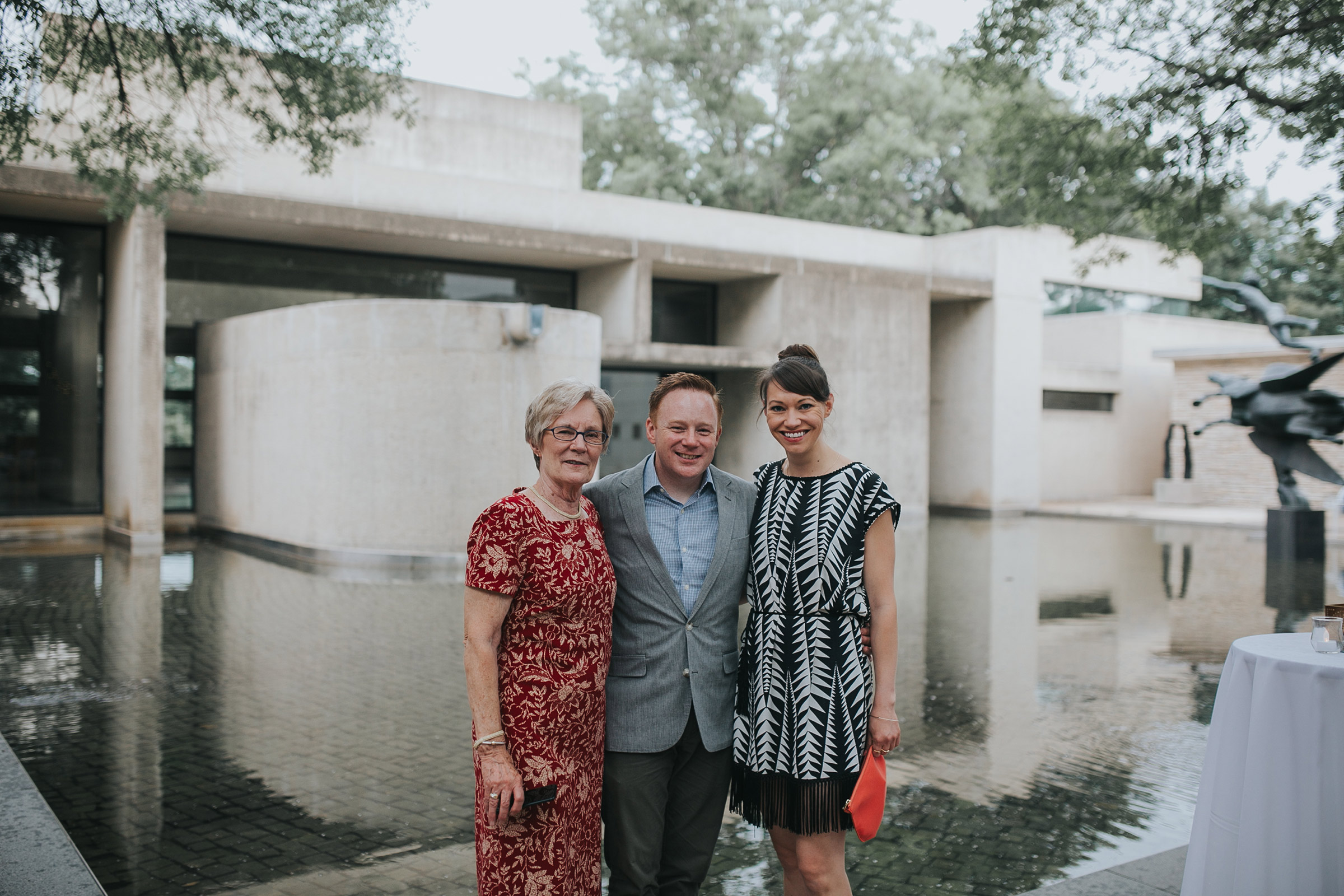 guests-posing-in-front-of-fountain-desmoines-iowa-art-center-raelyn-ramey-photography.jpg