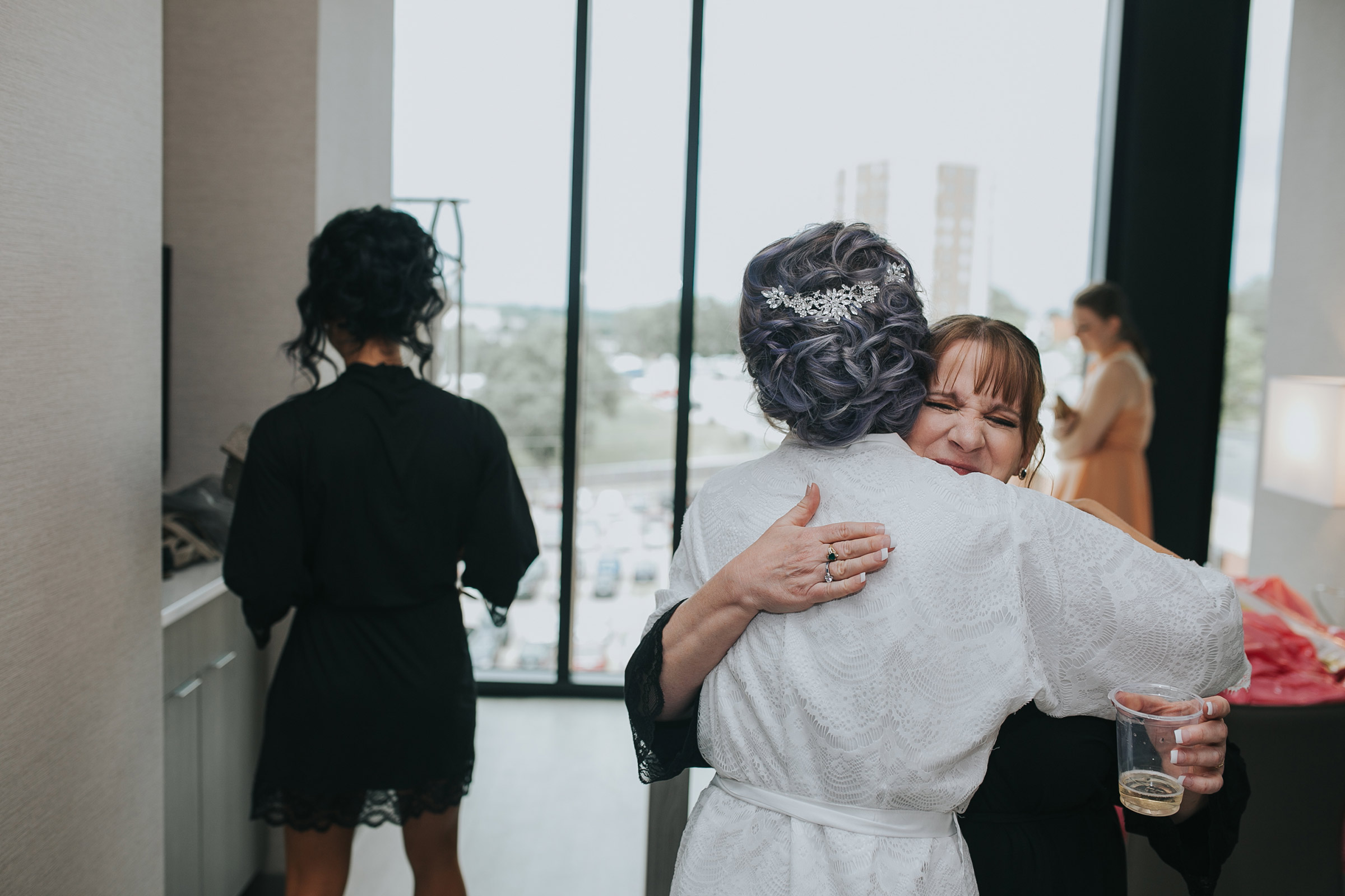 mother-of-bride-hugging-bride-desmoines-iowa-ac-hotel-raelyn-ramey-photography.jpg