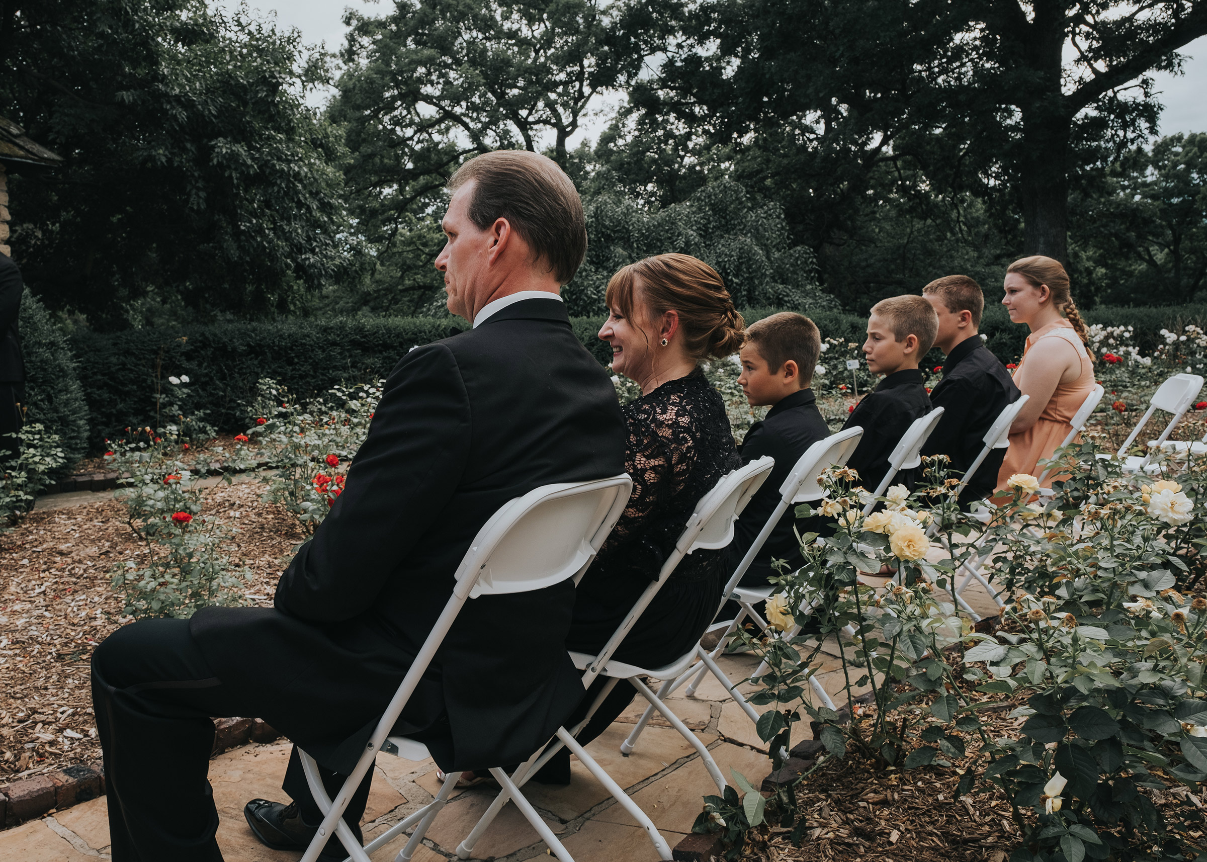 parents-watching-ceremony-desmoines-iowa-rose-garden-raelyn-ramey-photography.jpg