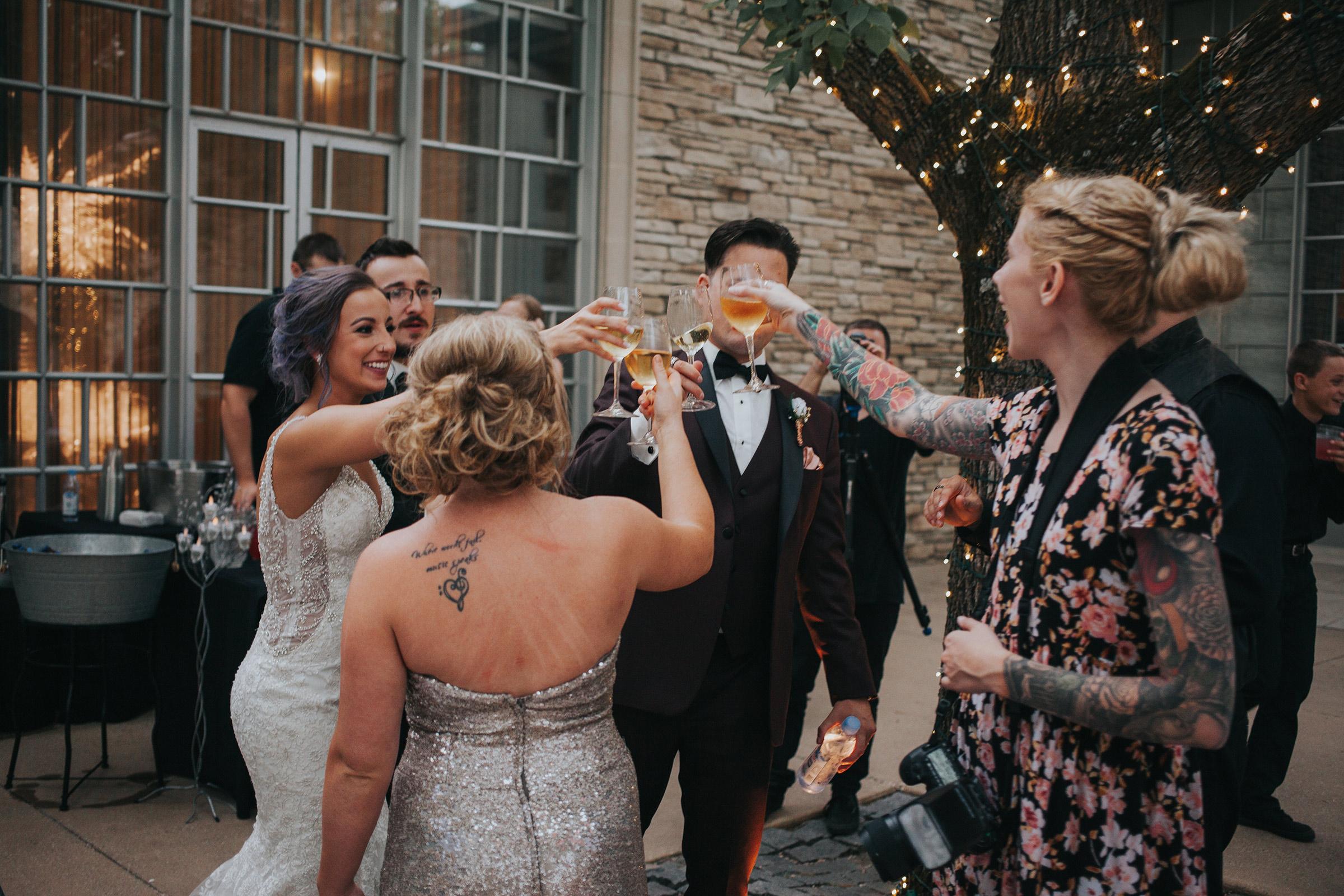 photographers-cheers-with-wedding-couple-desmoines-iowa-art-center-raelyn-ramey-photography.jpg