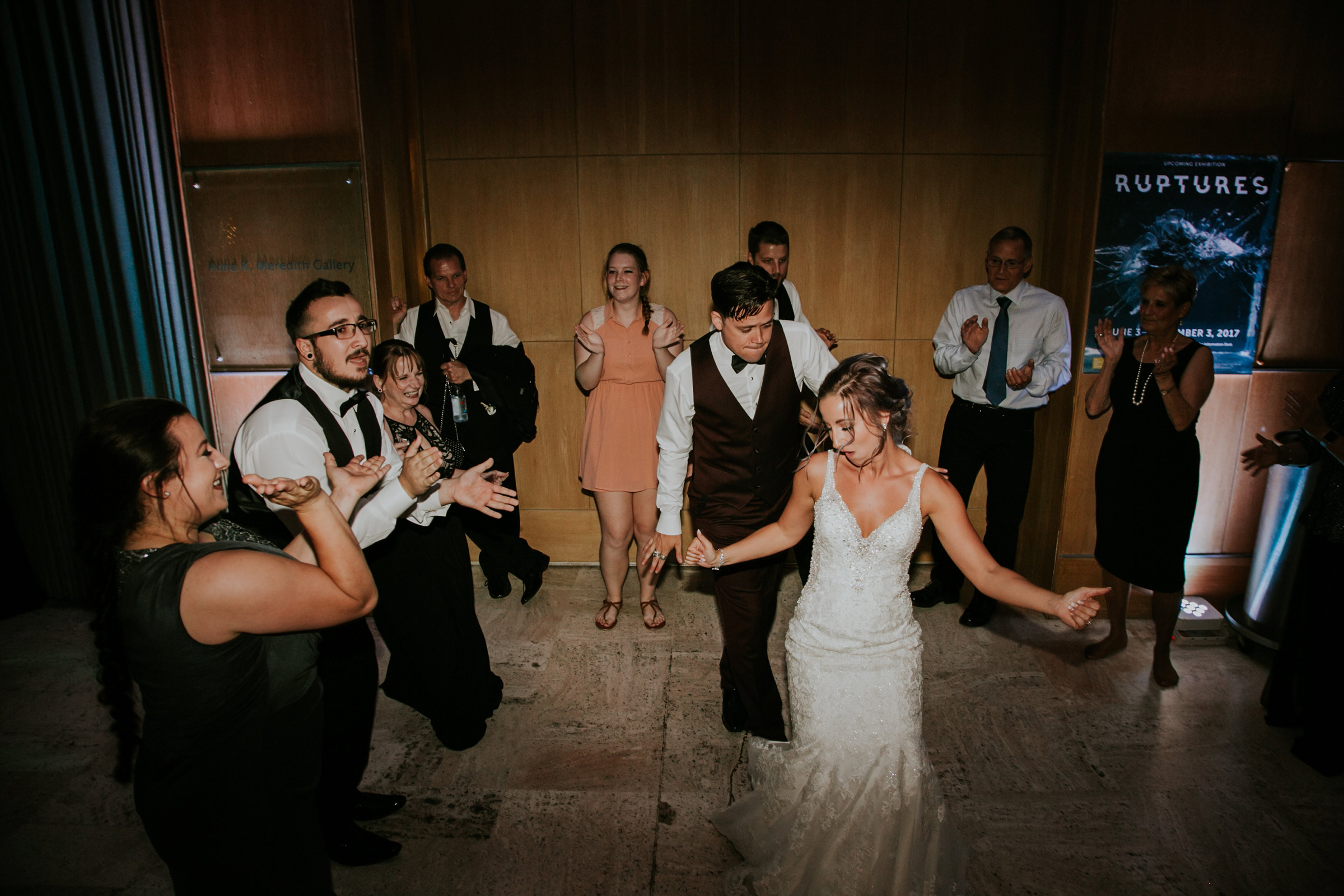 wedding-couple-dancing-with-people-surrounding-them-desmoines-iowa-art-center-raelyn-ramey-photography.jpg