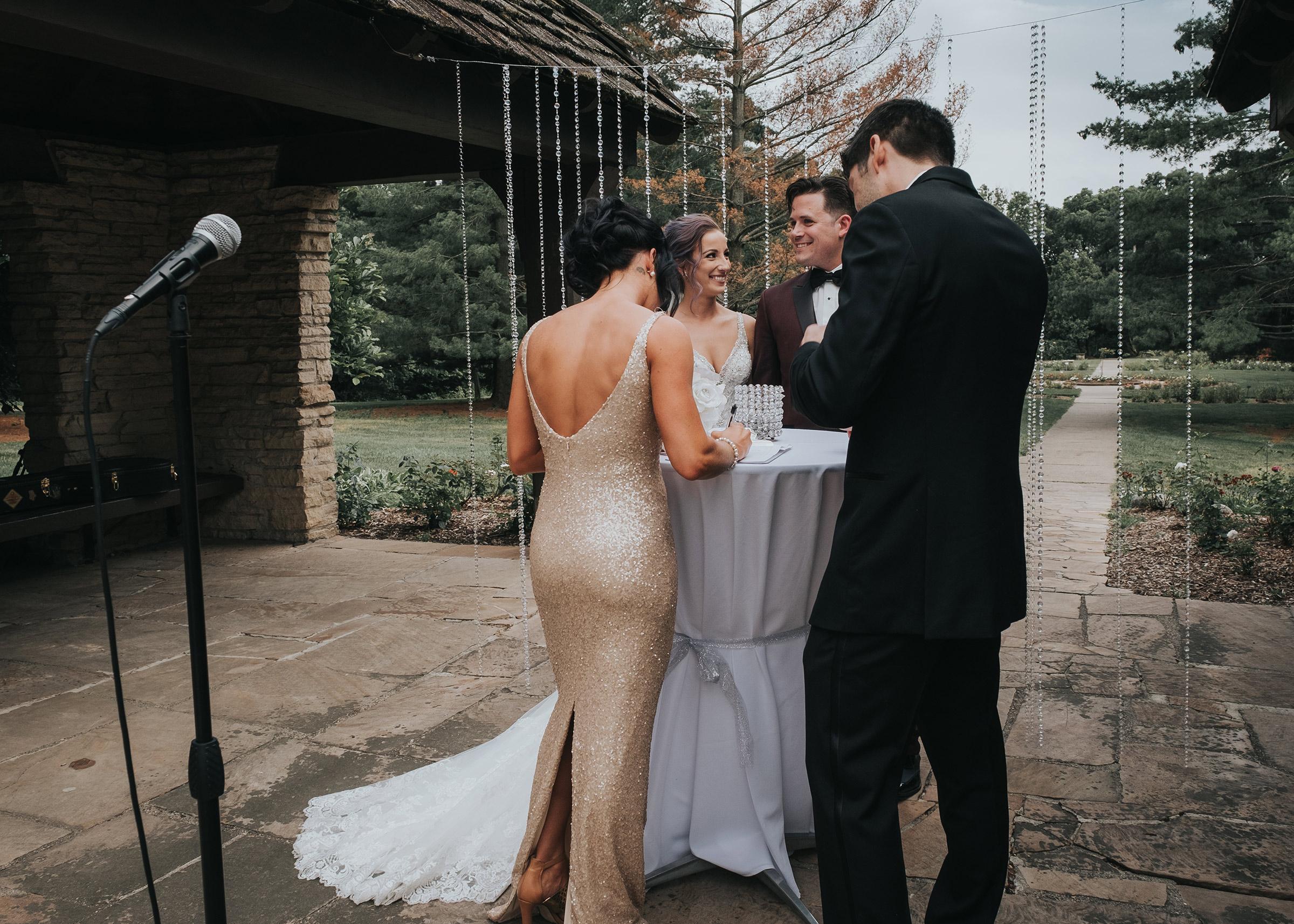 wedding-couple-signing-marriage-liscense-desmoines-iowa-rose-garden-raelyn-ramey-photography.jpg