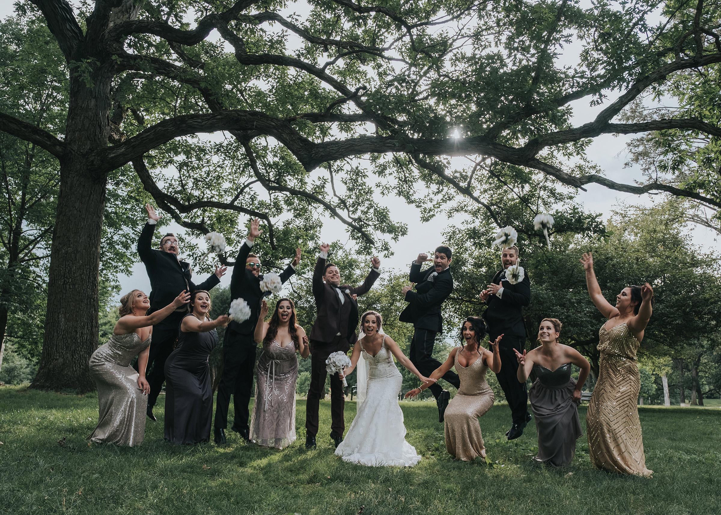 wedding-party-jumping-desmoines-iowa-art-center-raelyn-ramey-photography.jpg