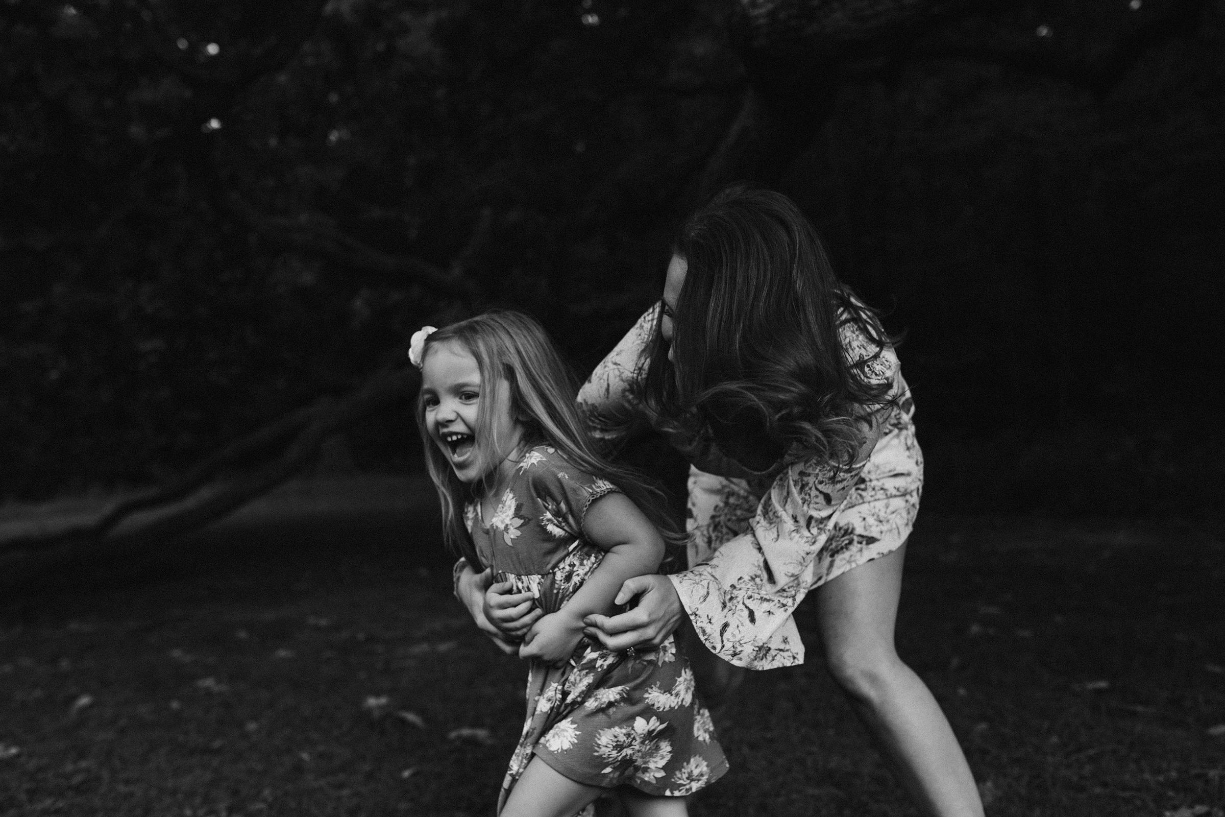 mueller-family-mom-catching-daughter-granger-iowa-raelyn-ramey-photography.jpg
