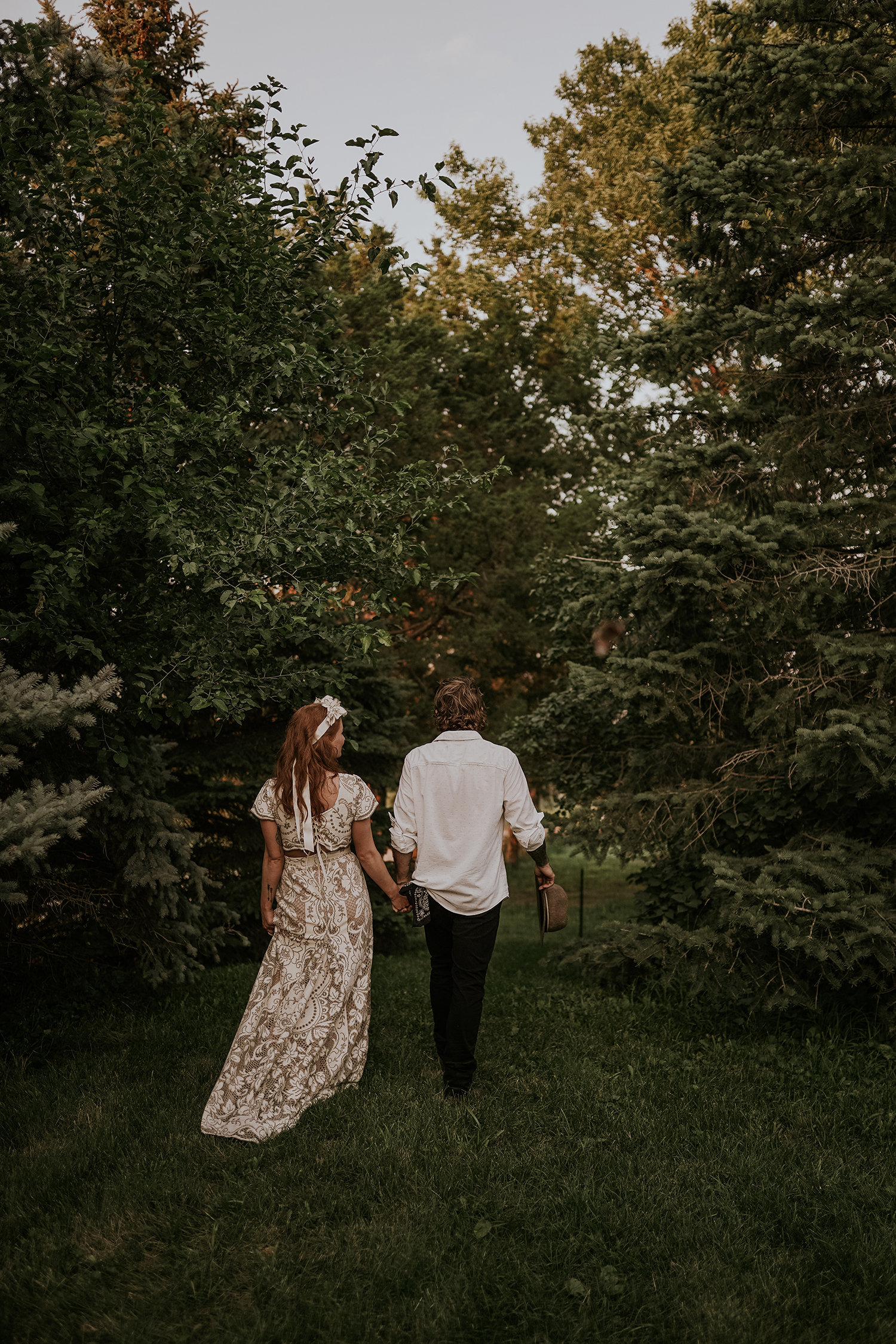 bride-groom-walking-through-trees-myrtle-mae-iris-aisle-dame-maiden-lavender-blue-floral-raelyn-ramey-photography.jpg