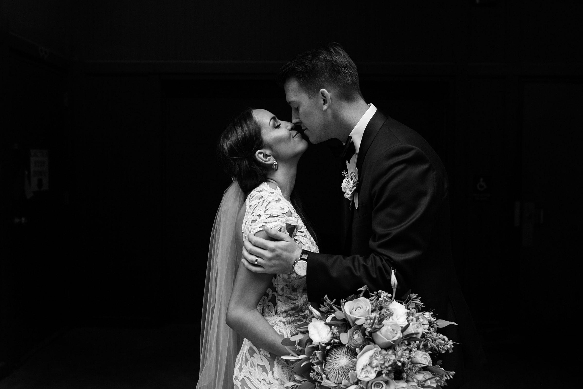 bride-groom-almost-kissing-downtown-omaha-nebraska-raelyn-ramey-photography.jpg