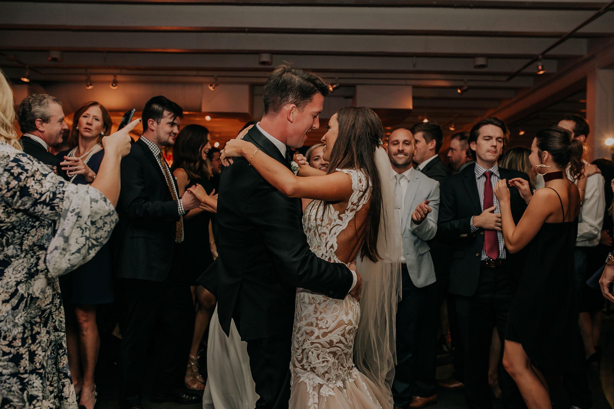 bride-groom-dancing-with-guests-surrounding-them-founders-one-nine-omaha-nebraska-raelyn-ramey-photography.jpg