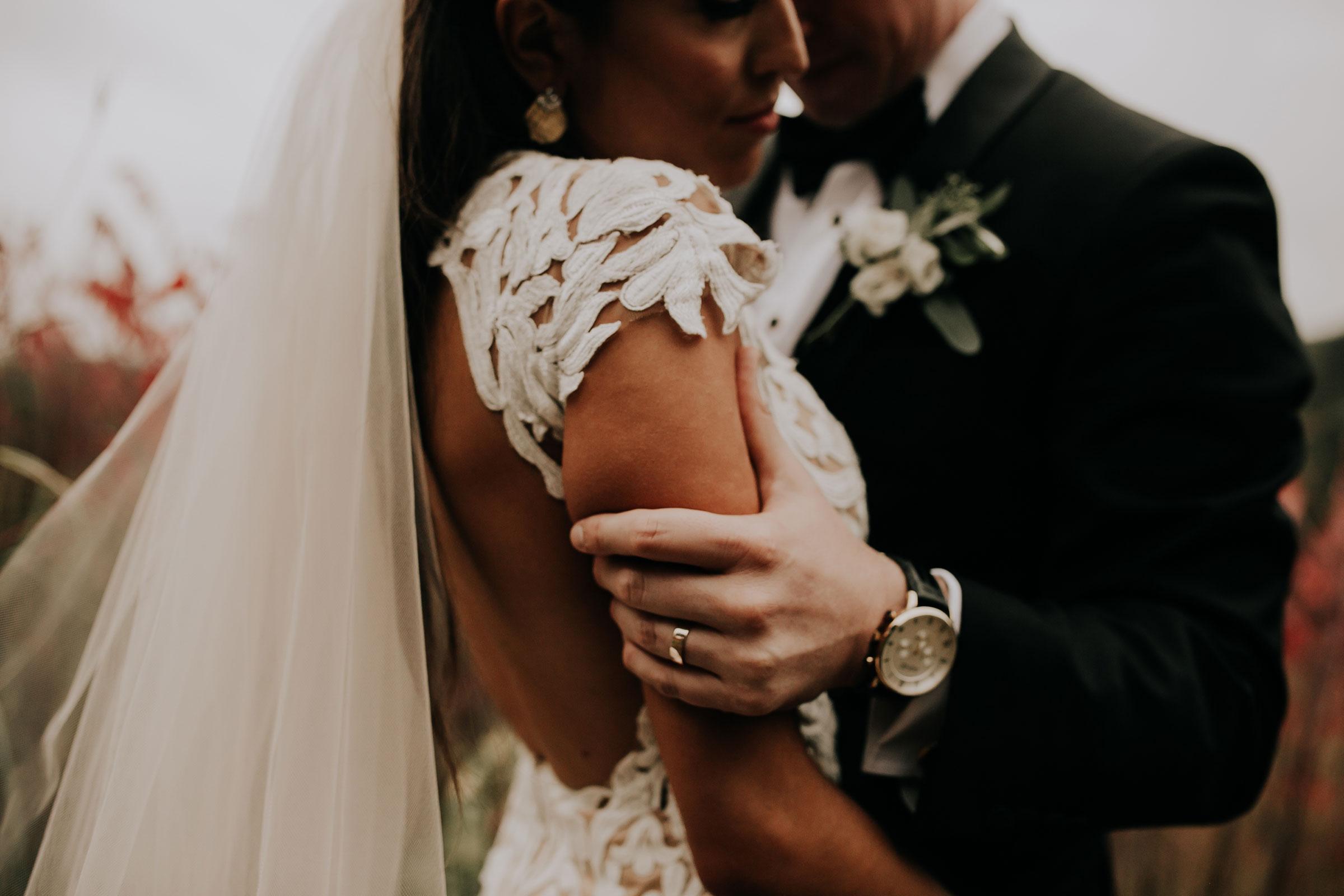 bride-groom-holding-each-other-at-park-omaha-nebraska-raelyn-ramey-photography.jpg