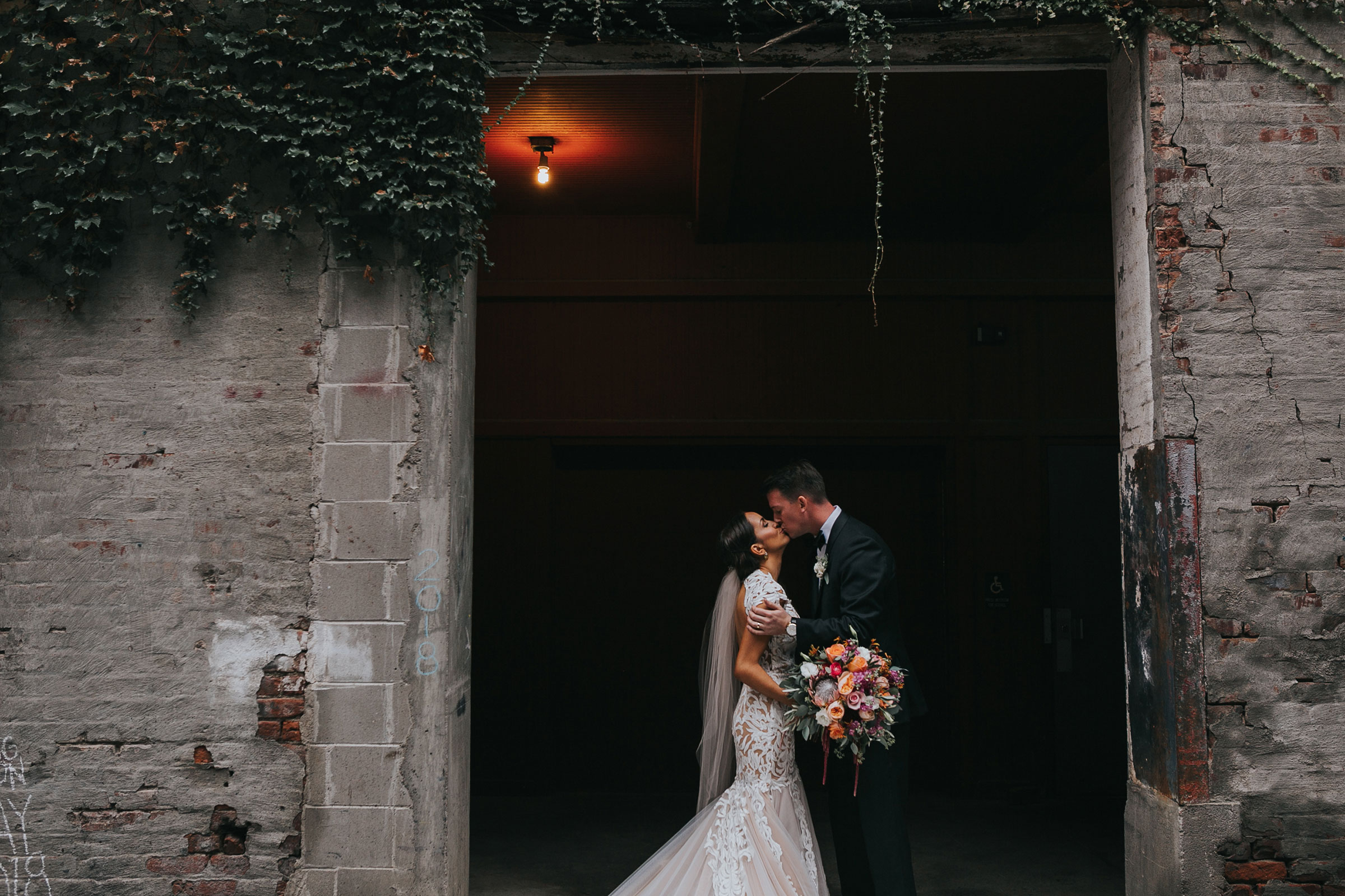 bride-groom-kissing-in-downtown-omaha-nebraska-raelyn-ramey-photography.jpg