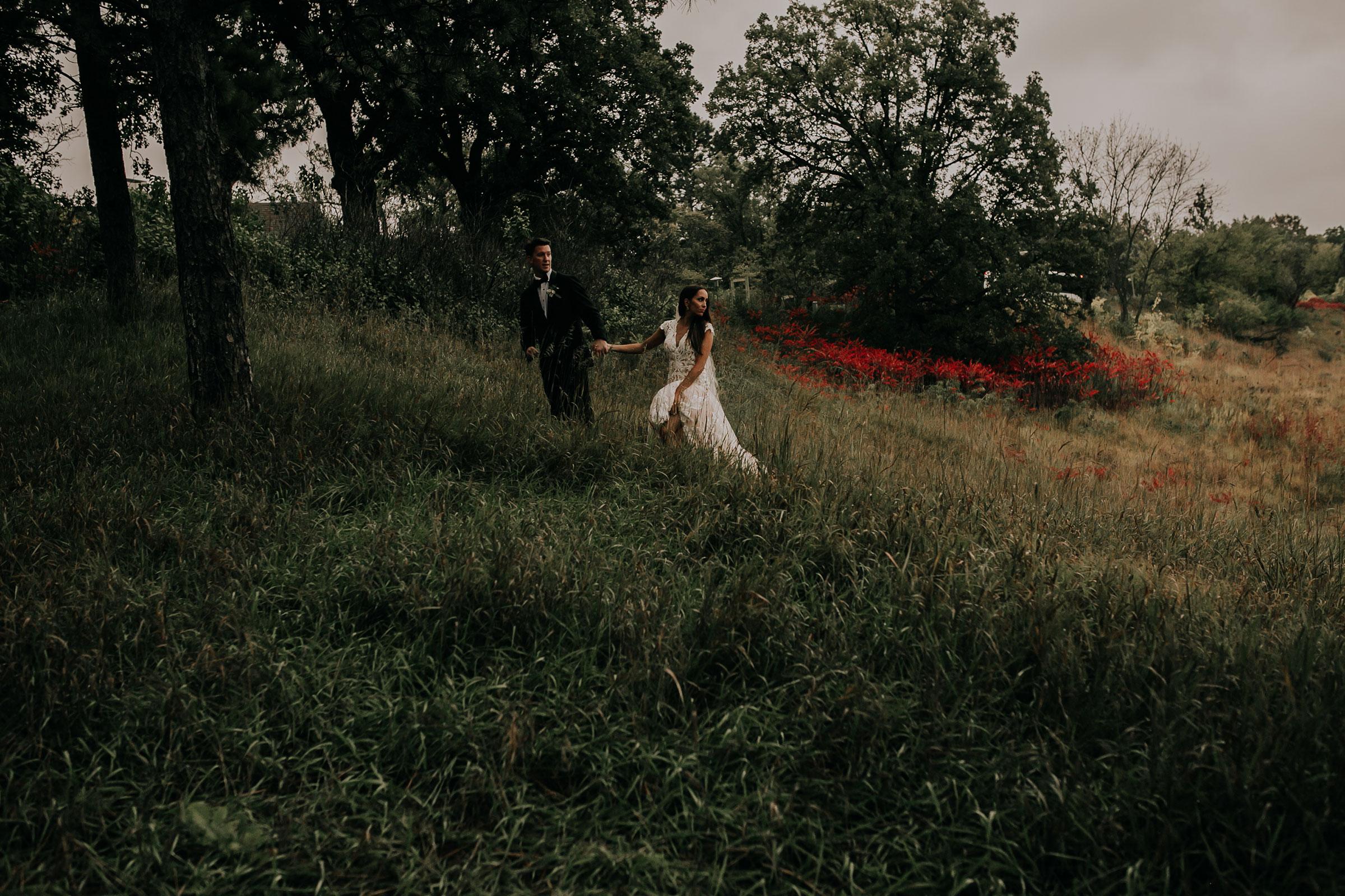 bride-groom-walking-up-hill-at-park-omaha-nebraska-raelyn-ramey-photography.jpg