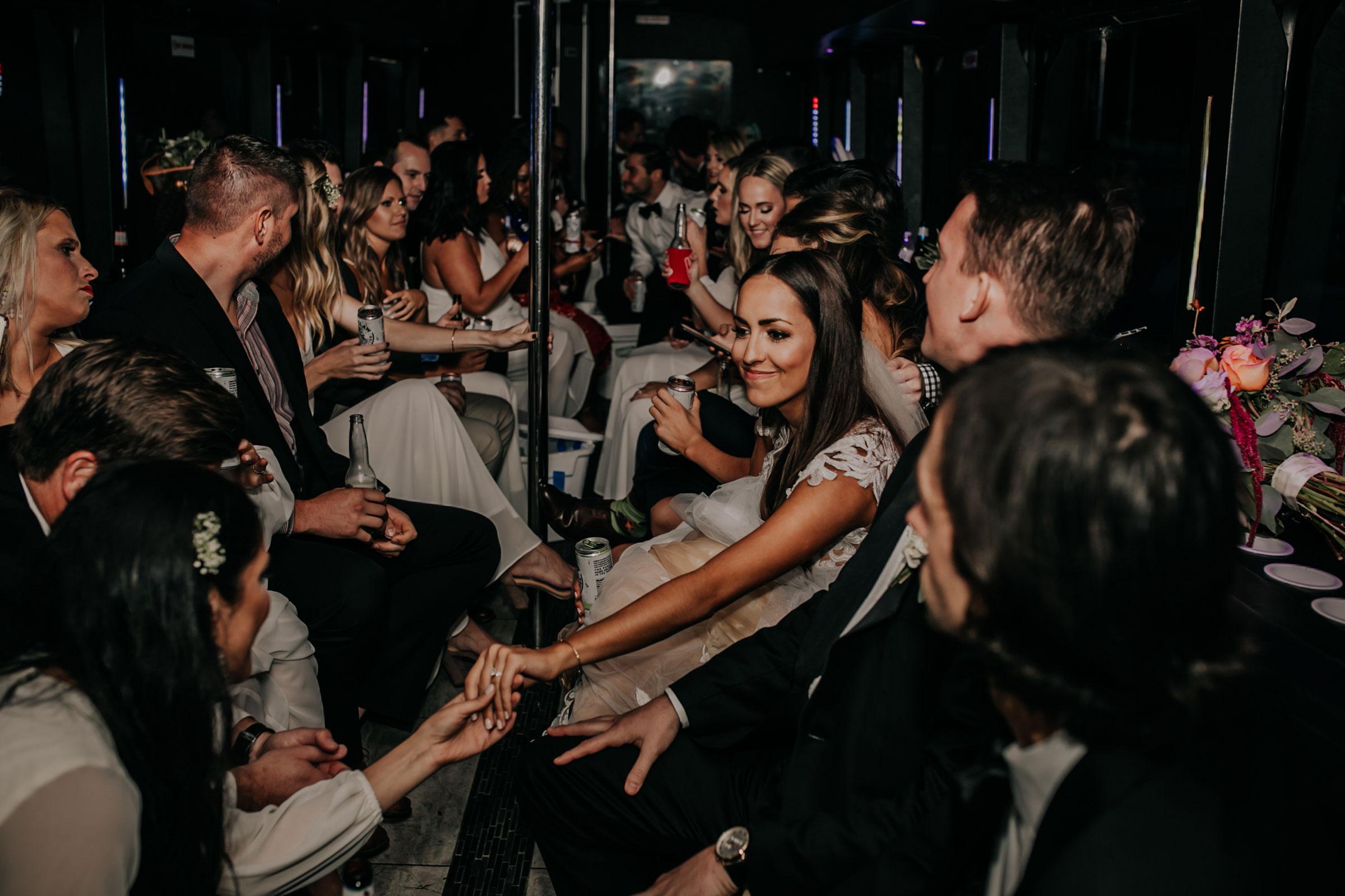 bride-showing-off-wedding-ring-on-party-bus-omaha-nebraska-raelyn-ramey-photography.jpg