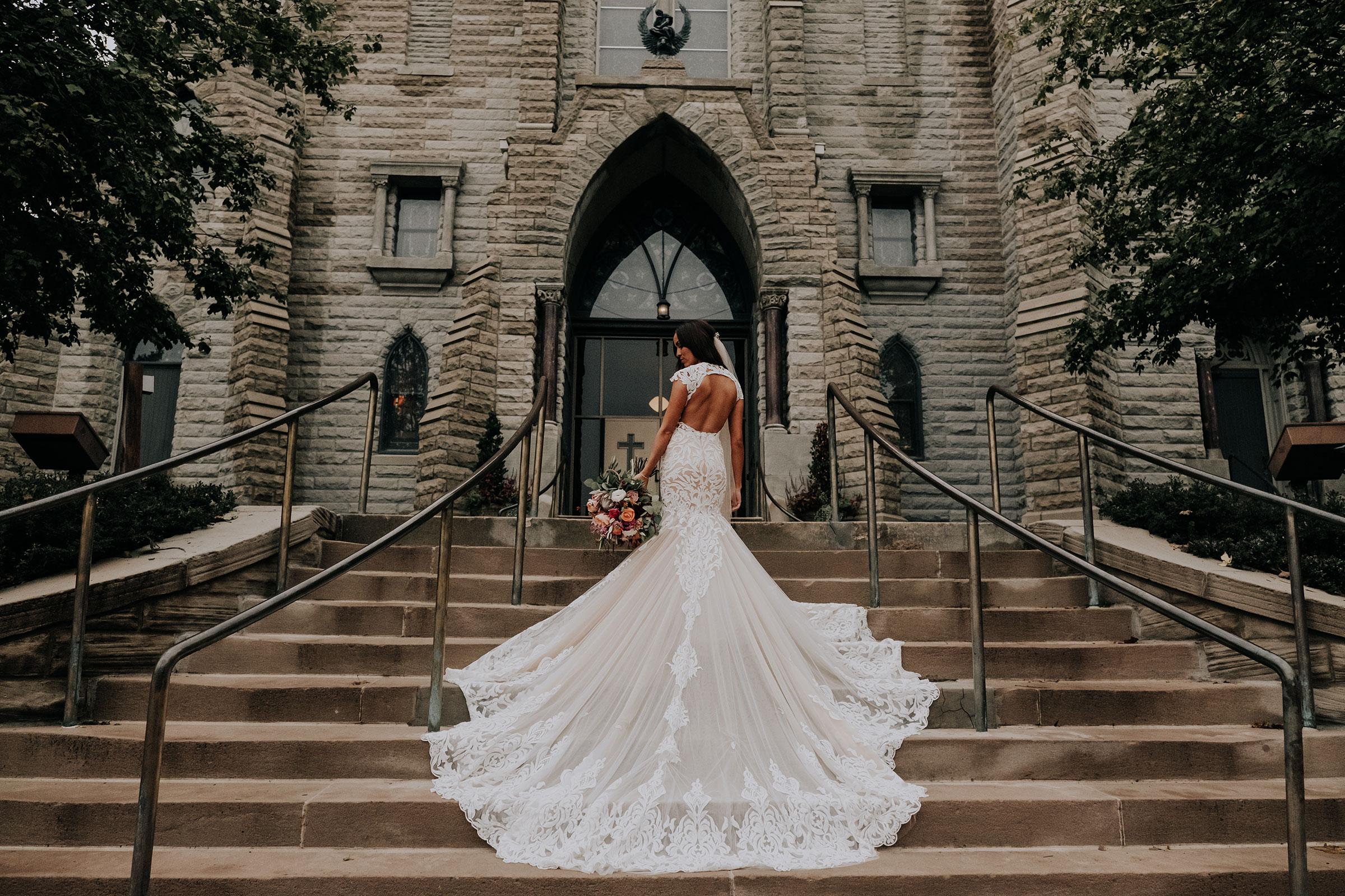 bride-posing-on-stairs-at-st-johns-church-at-creighton-omaha-nebraska-raelyn-ramey-photography.jpg