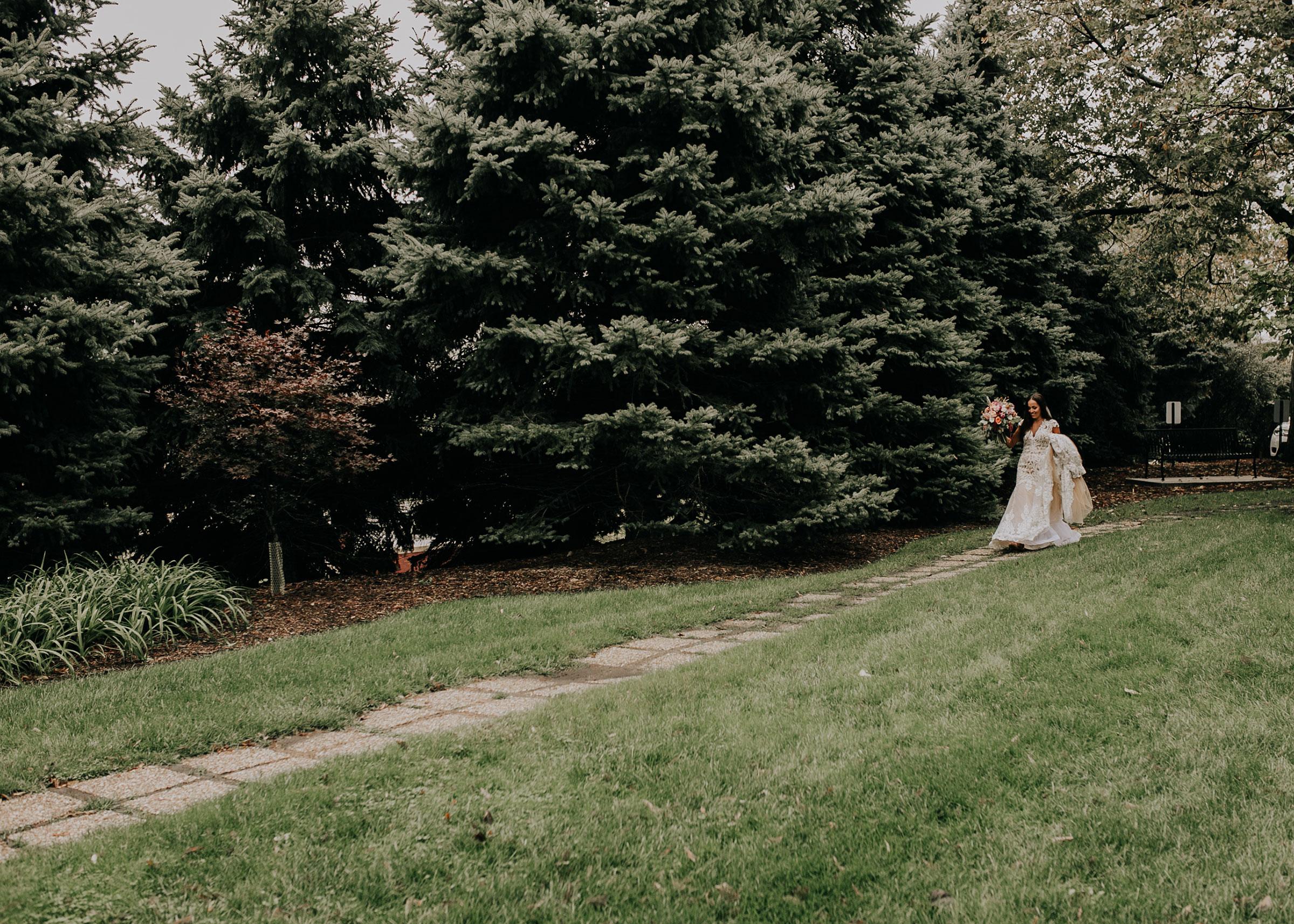 bride-walking-to-groom-for-first-look-st-johns-church-at-creighton-omaha-nebraska-raelyn-ramey-photography.jpg