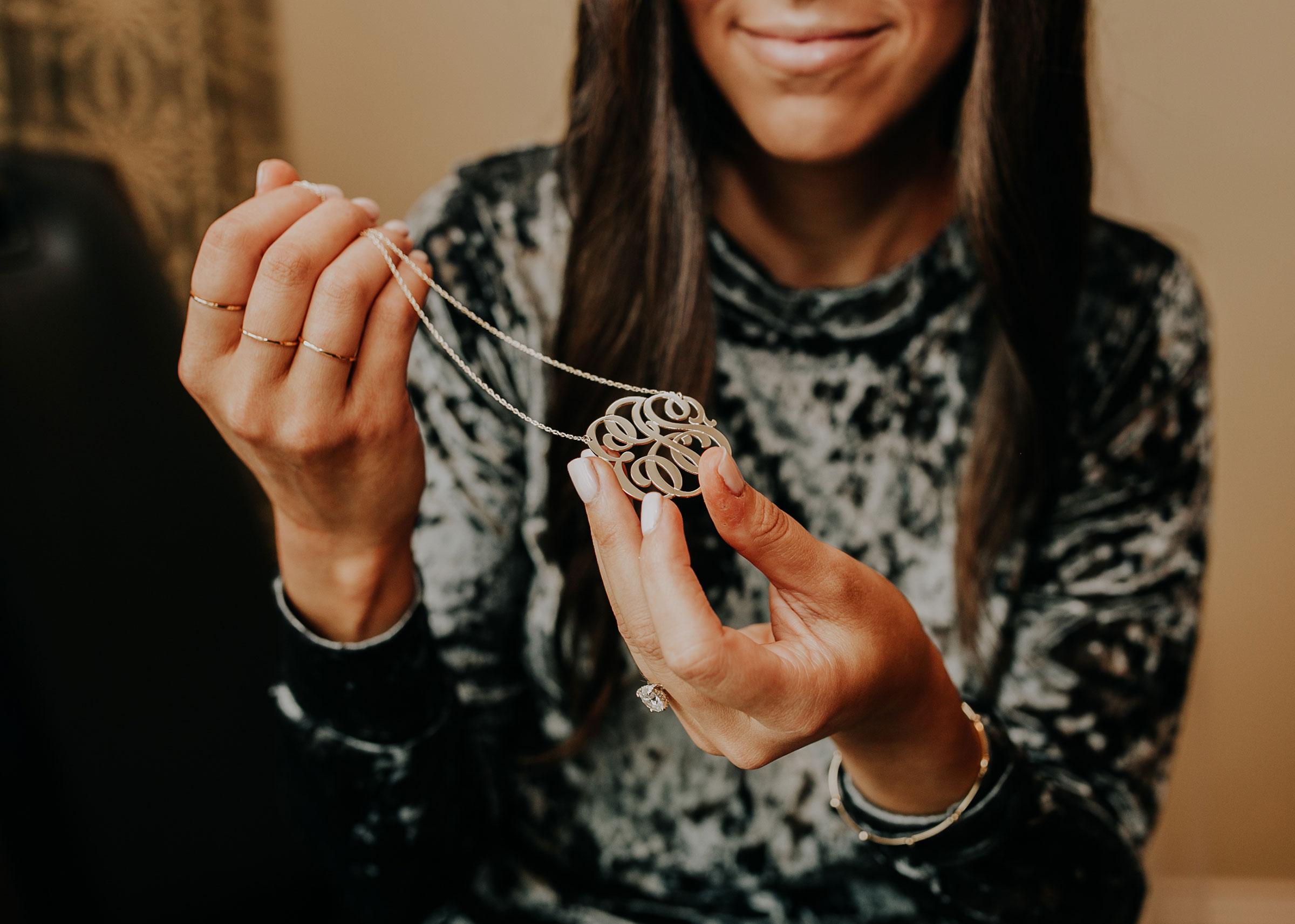bride-with-necklace-from-groom-hilton-omaha-nebraska-raelyn-ramey-photography.jpg