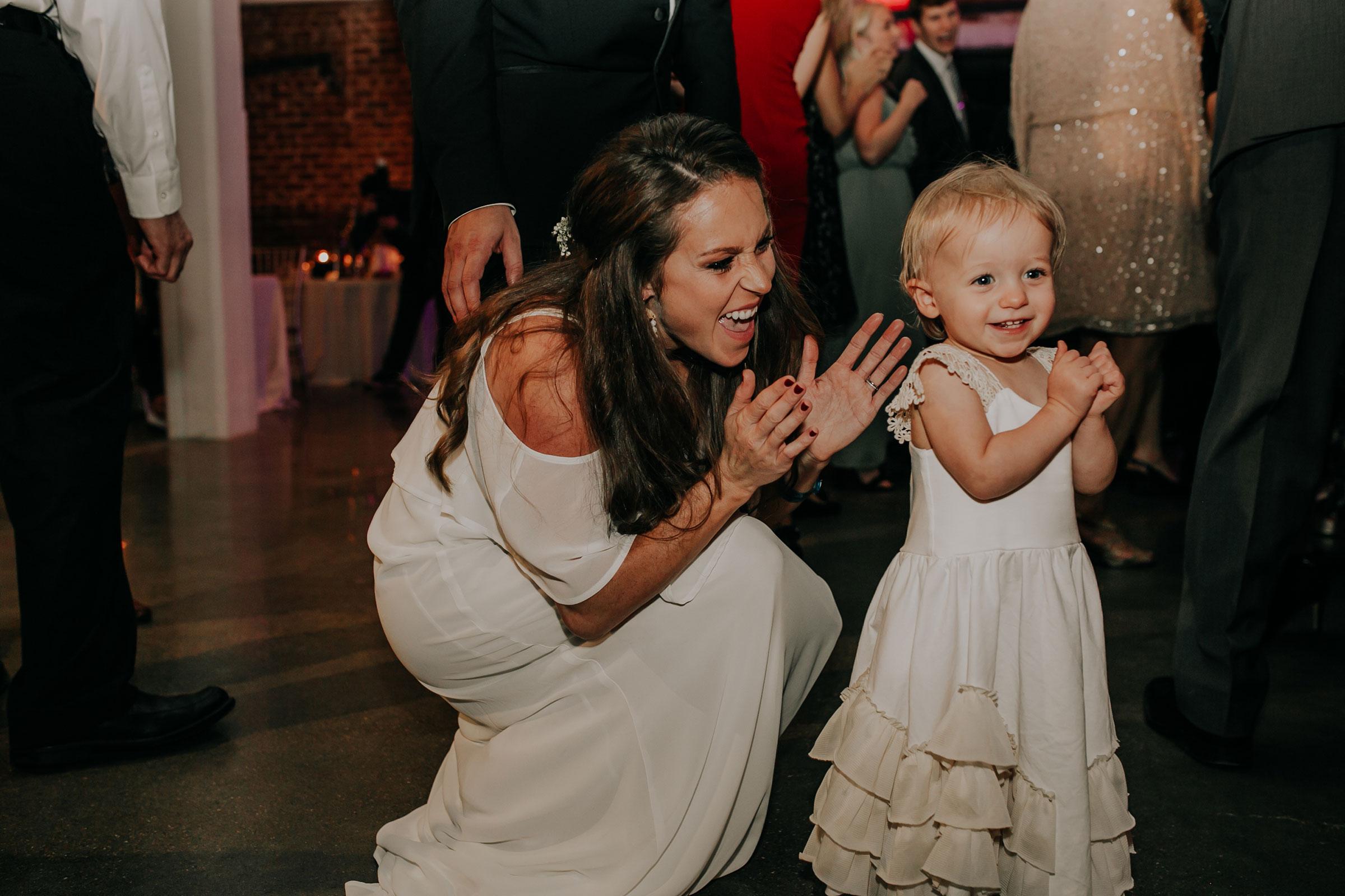bridesmaid-and-daughter-dancing-founders-one-nine-omaha-nebraska-raelyn-ramey-photography.jpg