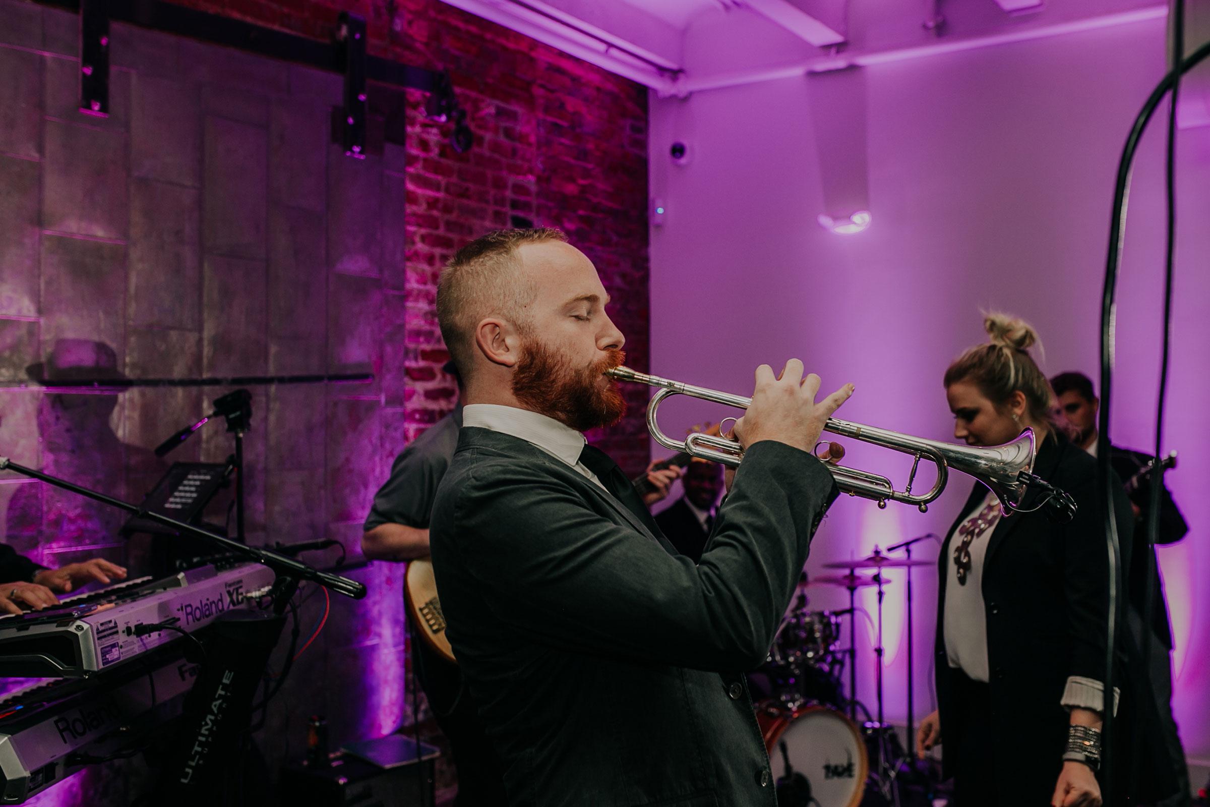 diamond-empire-band-playing-trumpet-founders-one-nine-omaha-nebraska-raelyn-ramey-photography.jpg