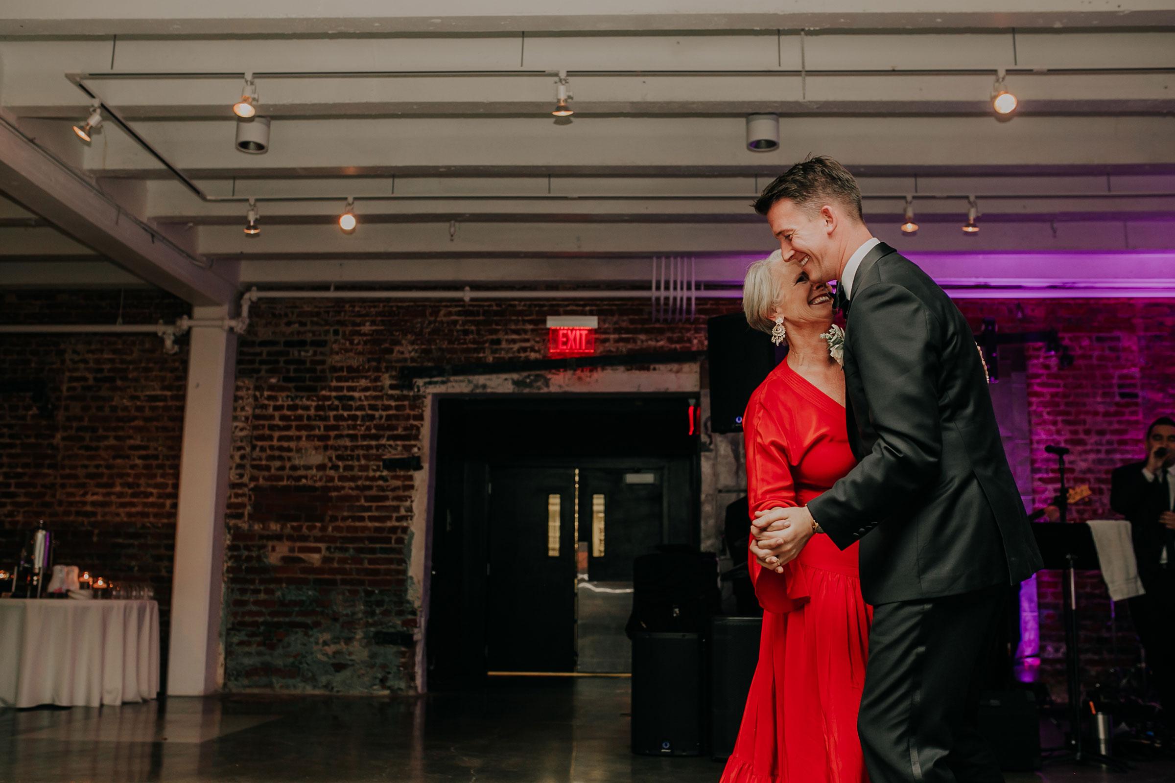 first-dance-with-groom-and-mother-founders-one-nine-omaha-nebraska-raelyn-ramey-photography.jpg