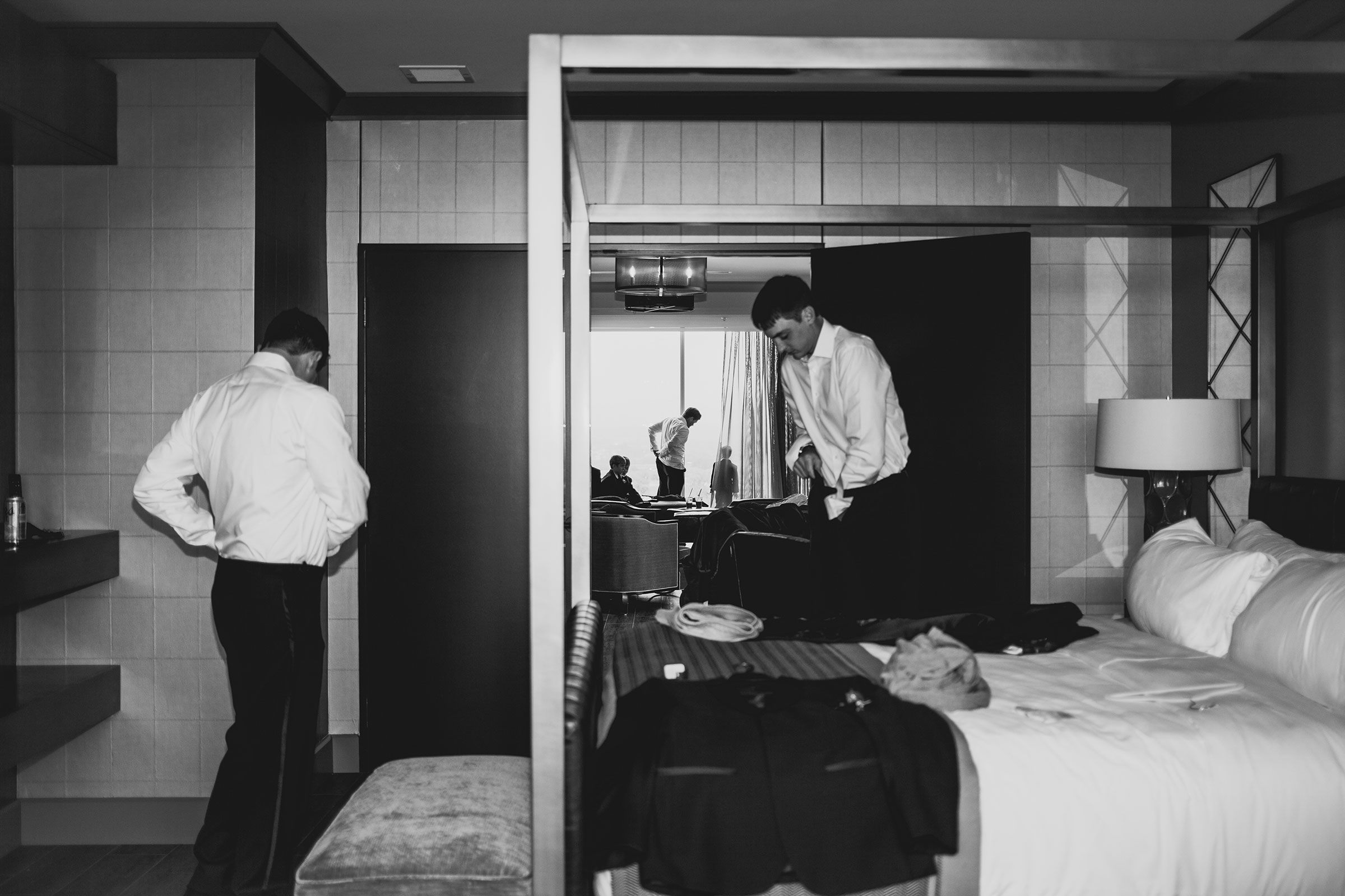 groom-and-groomsmen-getting-ready-hilton-omaha-nebraska-raelyn-ramey-photography.jpg