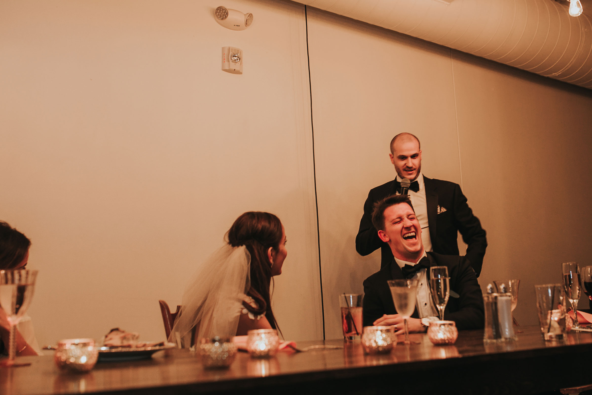 groom-laughing-at-best-man-speech-omaha-nebraska-raelyn-ramey-photography.jpg