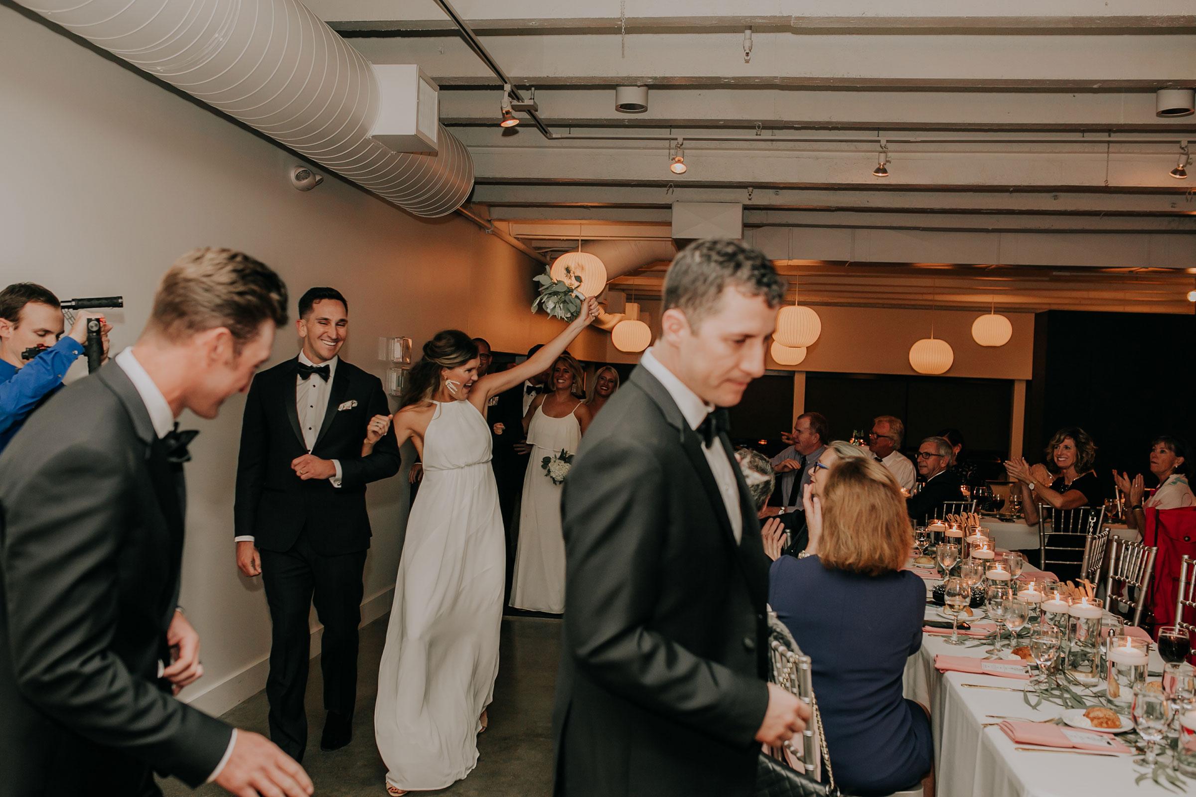 groomsmen-bridesmaid-grand-enterance-founders-one-nine-omaha-nebraska-raelyn-ramey-photography.jpg