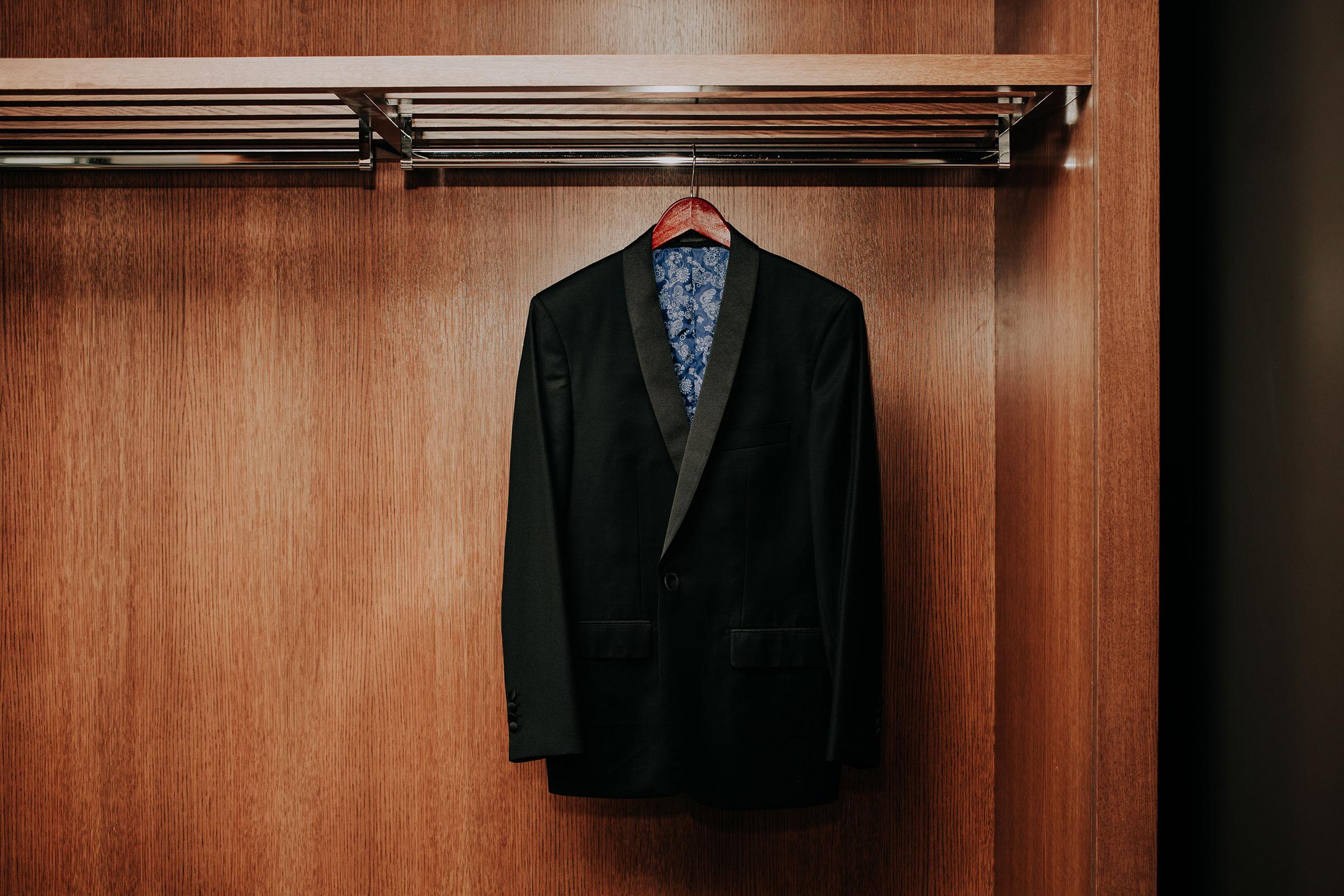 groomsmen-tux-hanging-up-hilton-omaha-nebraska-raelyn-ramey-photography.jpg