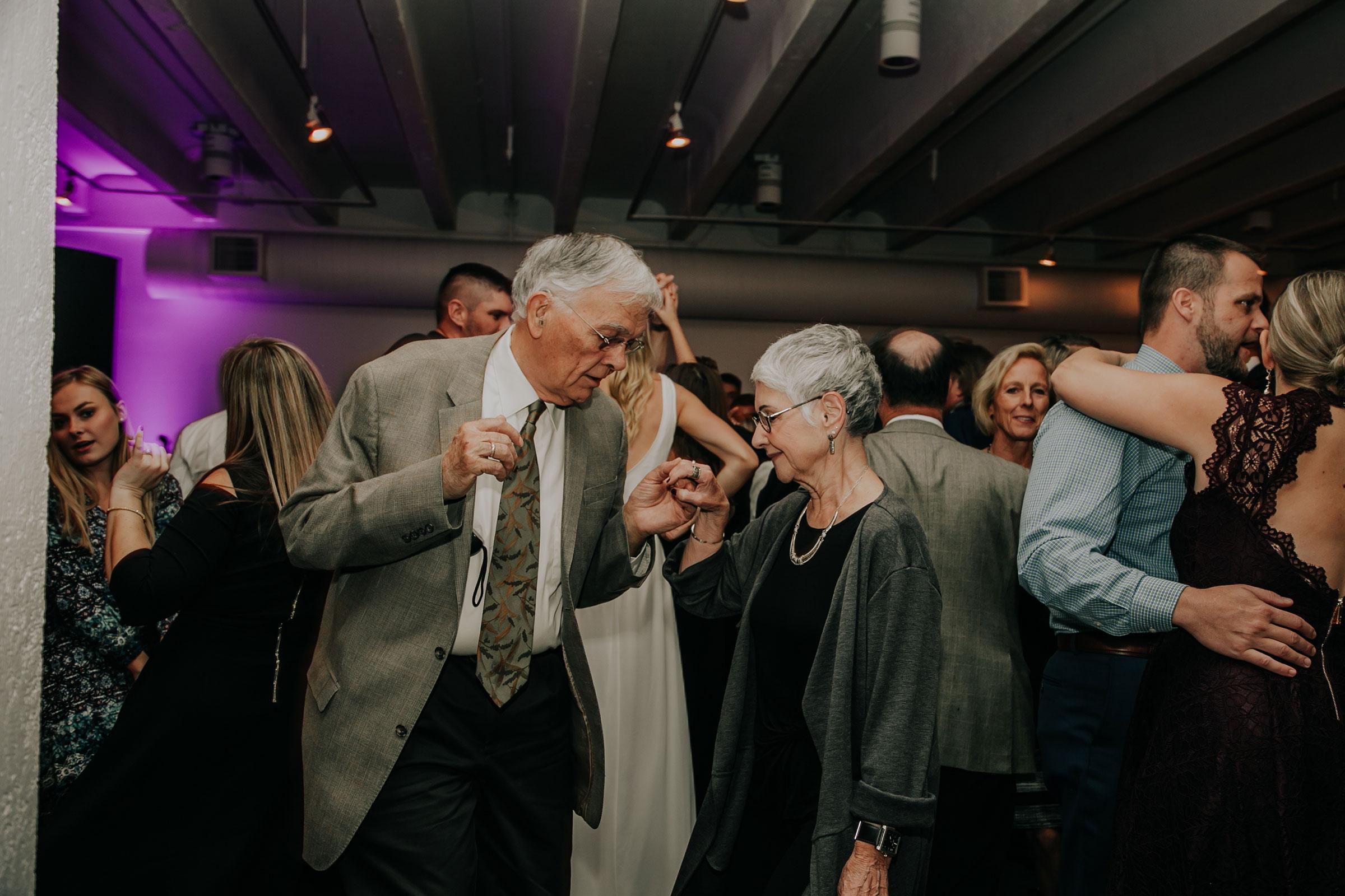 guests-dancing-at-reception-founders-one-nine-omaha-nebraska-raelyn-ramey-photography.jpg