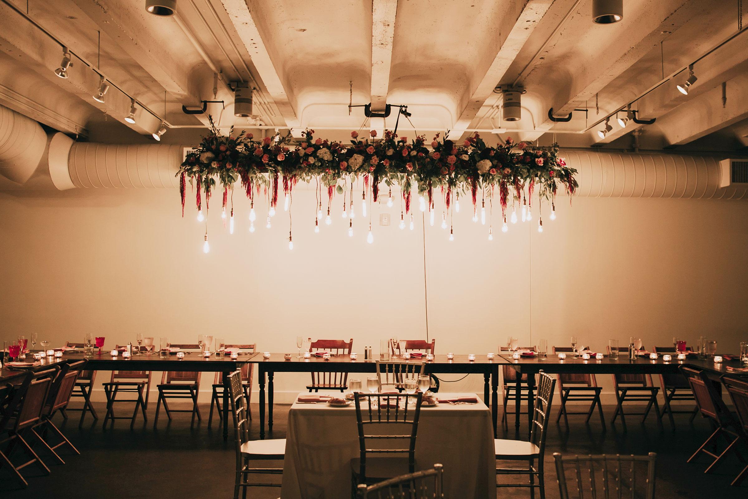 head-table-decorations-flowers-hanging-from-ceiling-founders-one-nine-omaha-nebraska-raelyn-ramey-photography.jpg