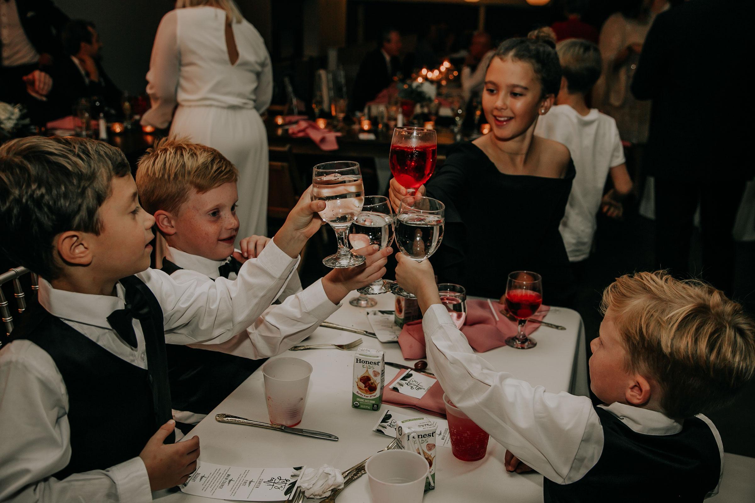 kids-toasting-at-reception-dinner-founders-one-nine-omaha-nebraska-raelyn-ramey-photography.jpg