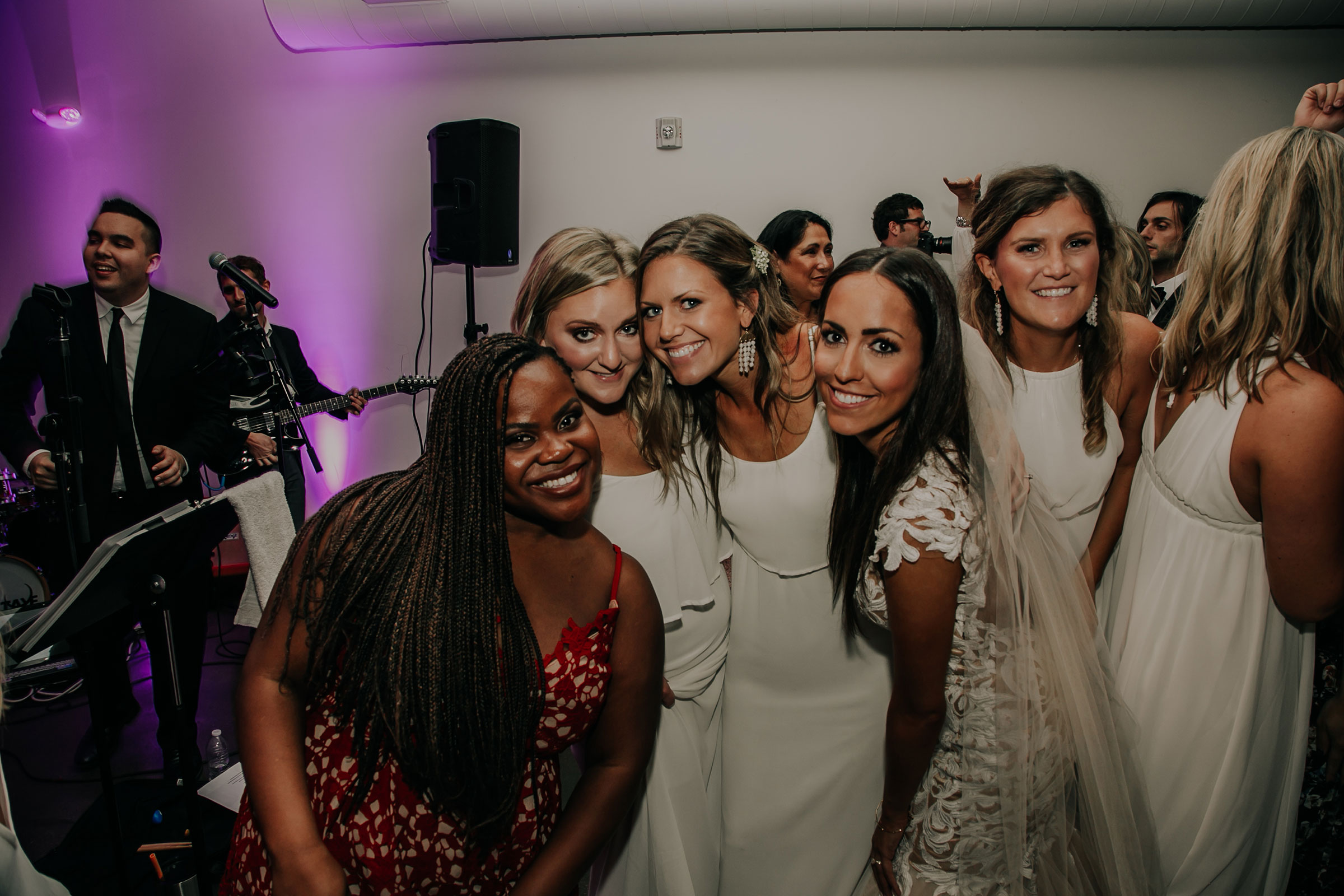 reception-dancing-with-bride-and-friends-founders-one-nine-omaha-nebraska-raelyn-ramey-photography.jpg
