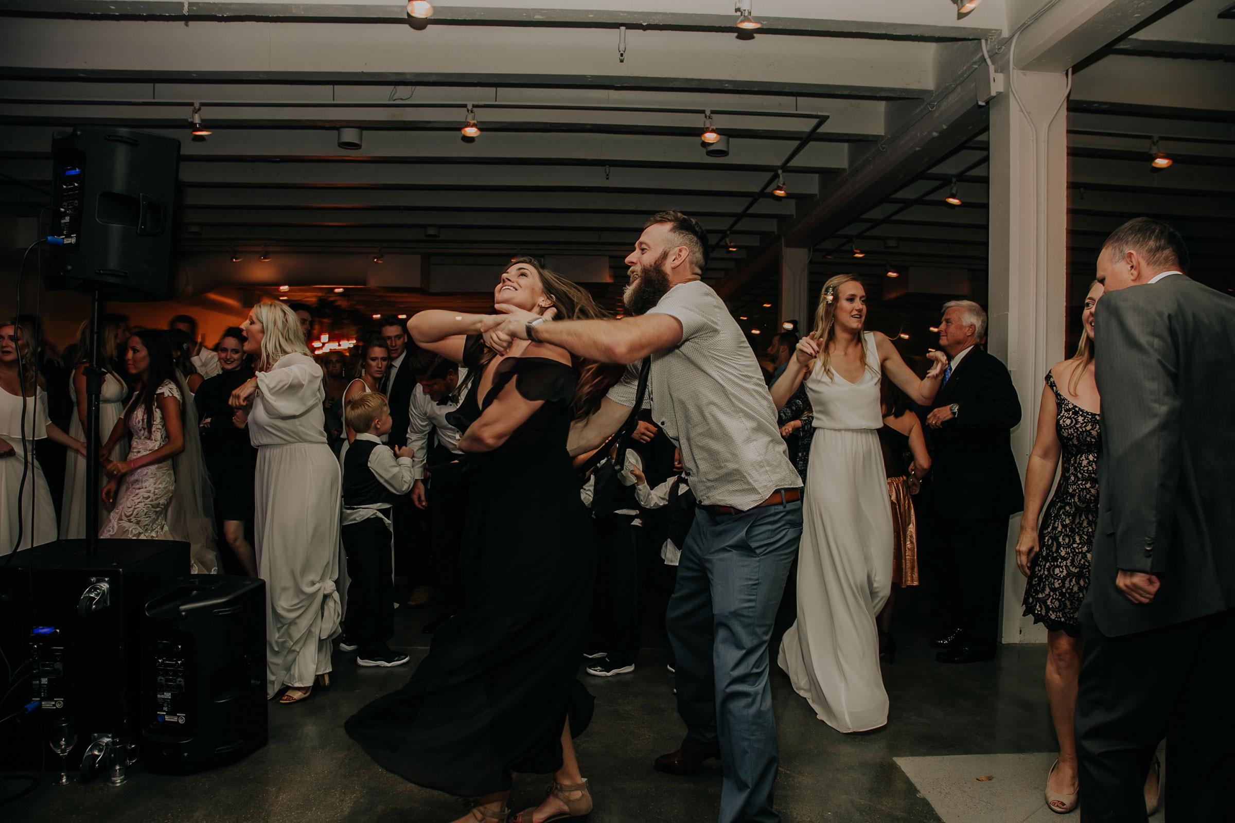 reception-guests-dancing-founders-one-nine-omaha-nebraska-raelyn-ramey-photography.jpg